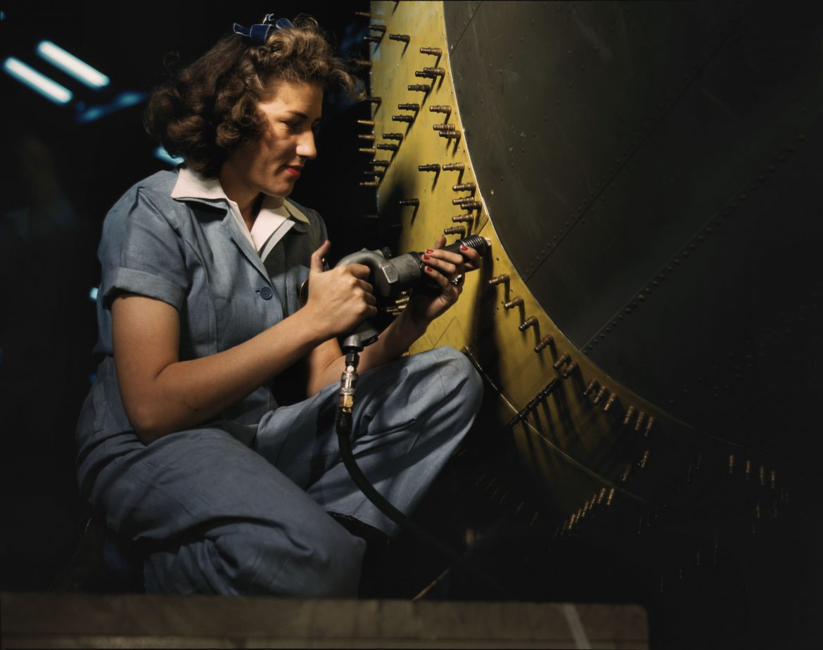 Riveter at Work on Consolidated Bomber
