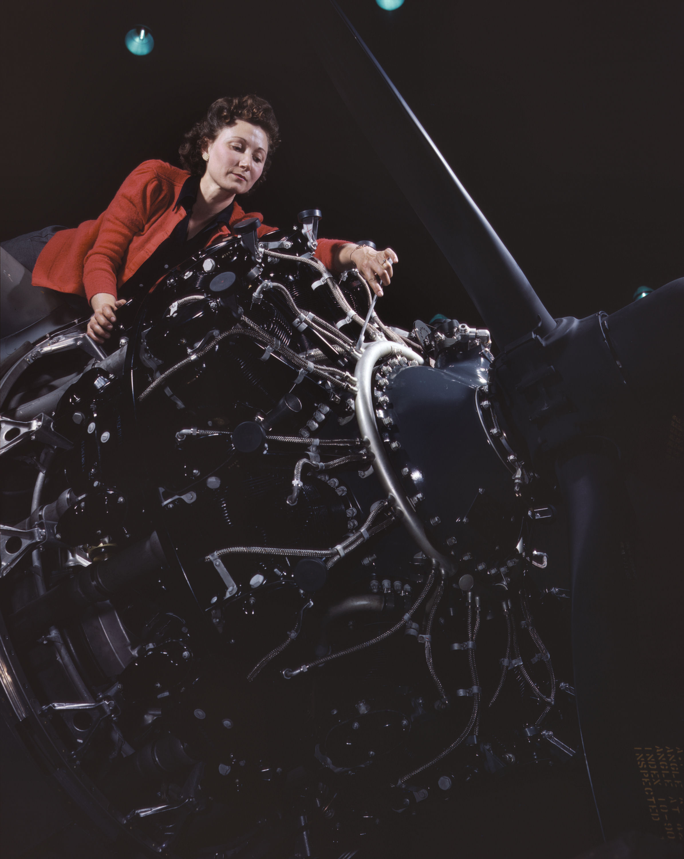 Woman at Work on Motor at Douglas Aircraft