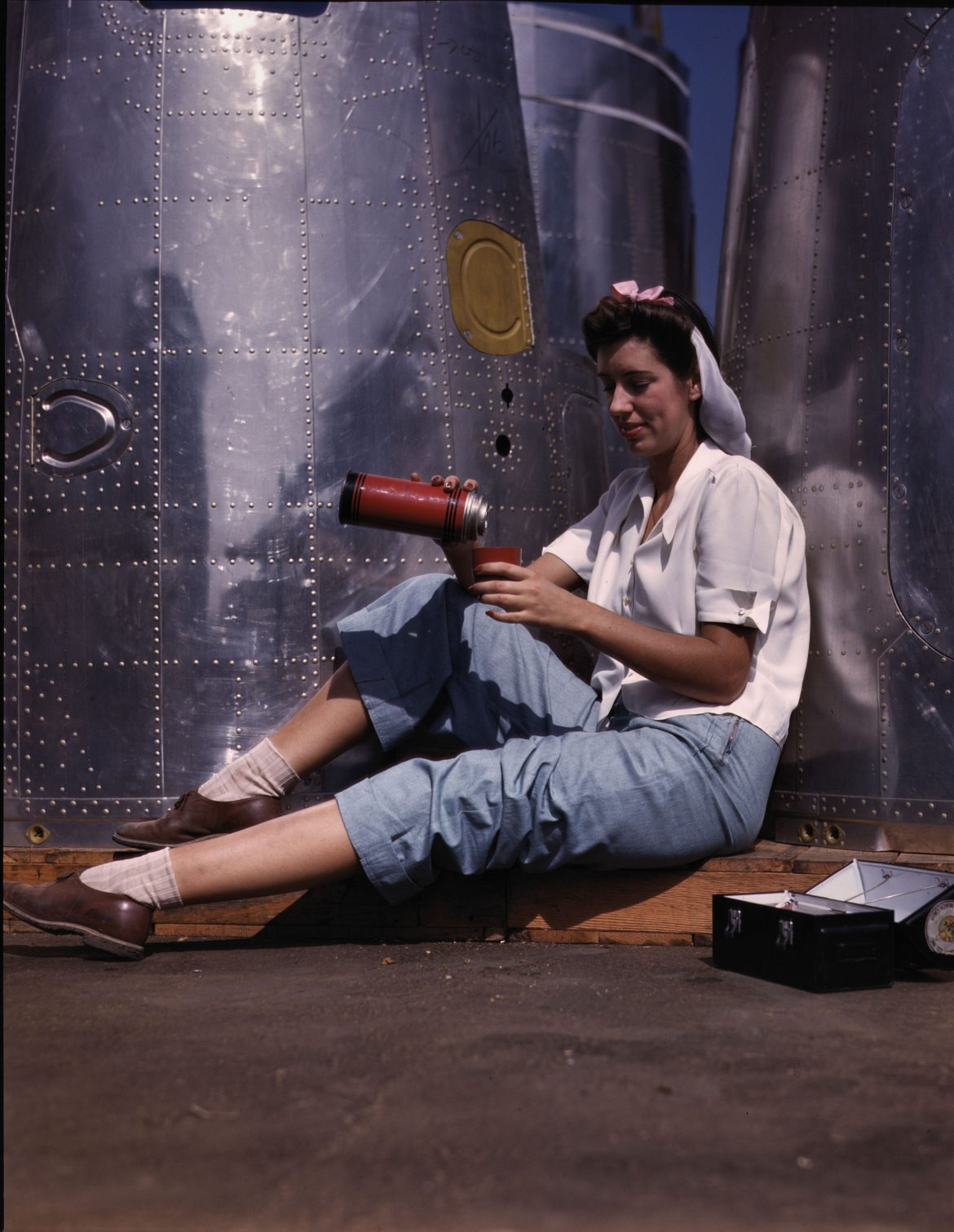 Worker Takes Lunch Break at Douglas Aircraft Company