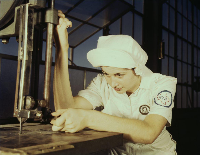 NYA Trainee Operates Cutting Machine at Naval Air Base