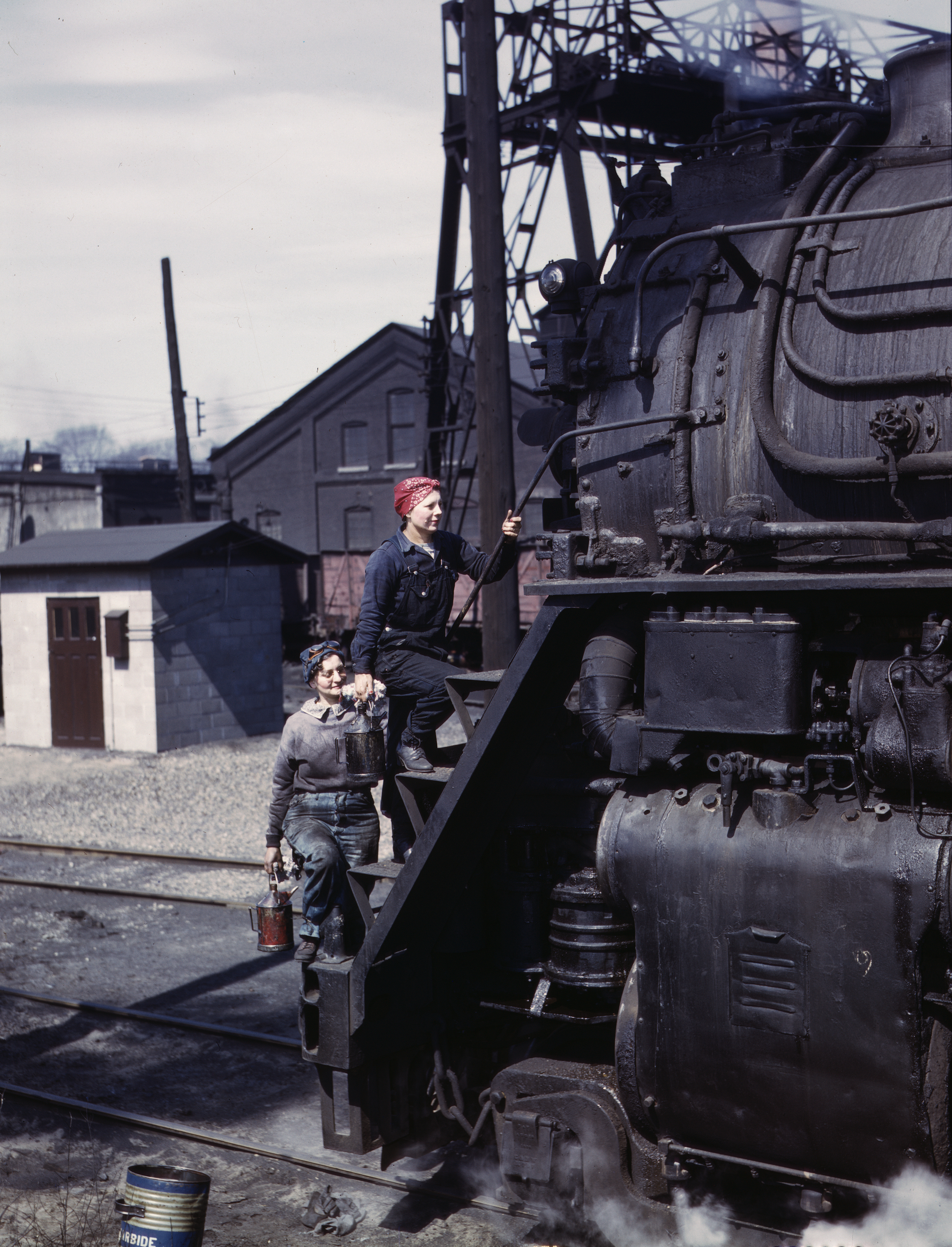 Women Railroad Workers Clean Giant Locomotive