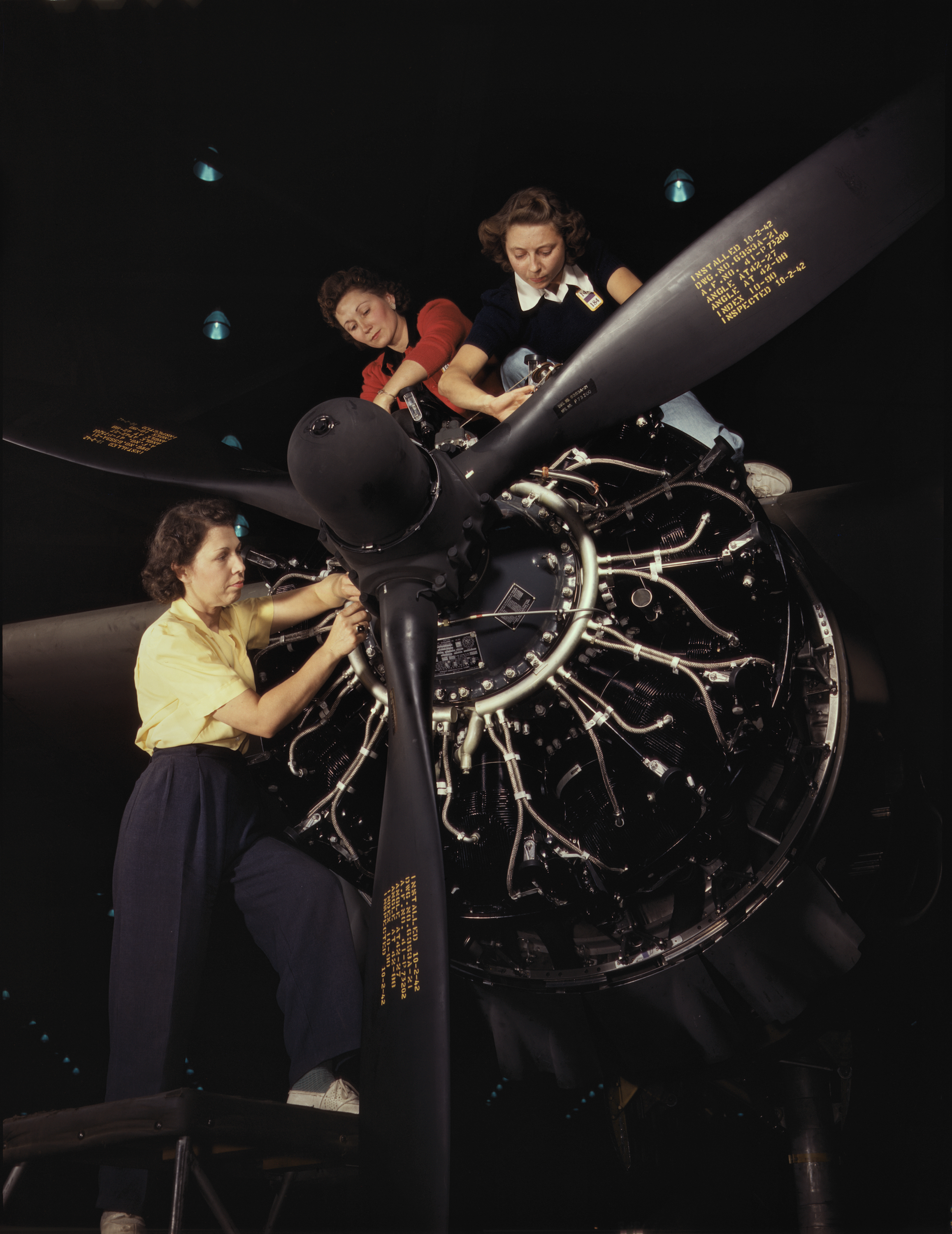 Aviation Workers Install Engines at Douglas Aircraft