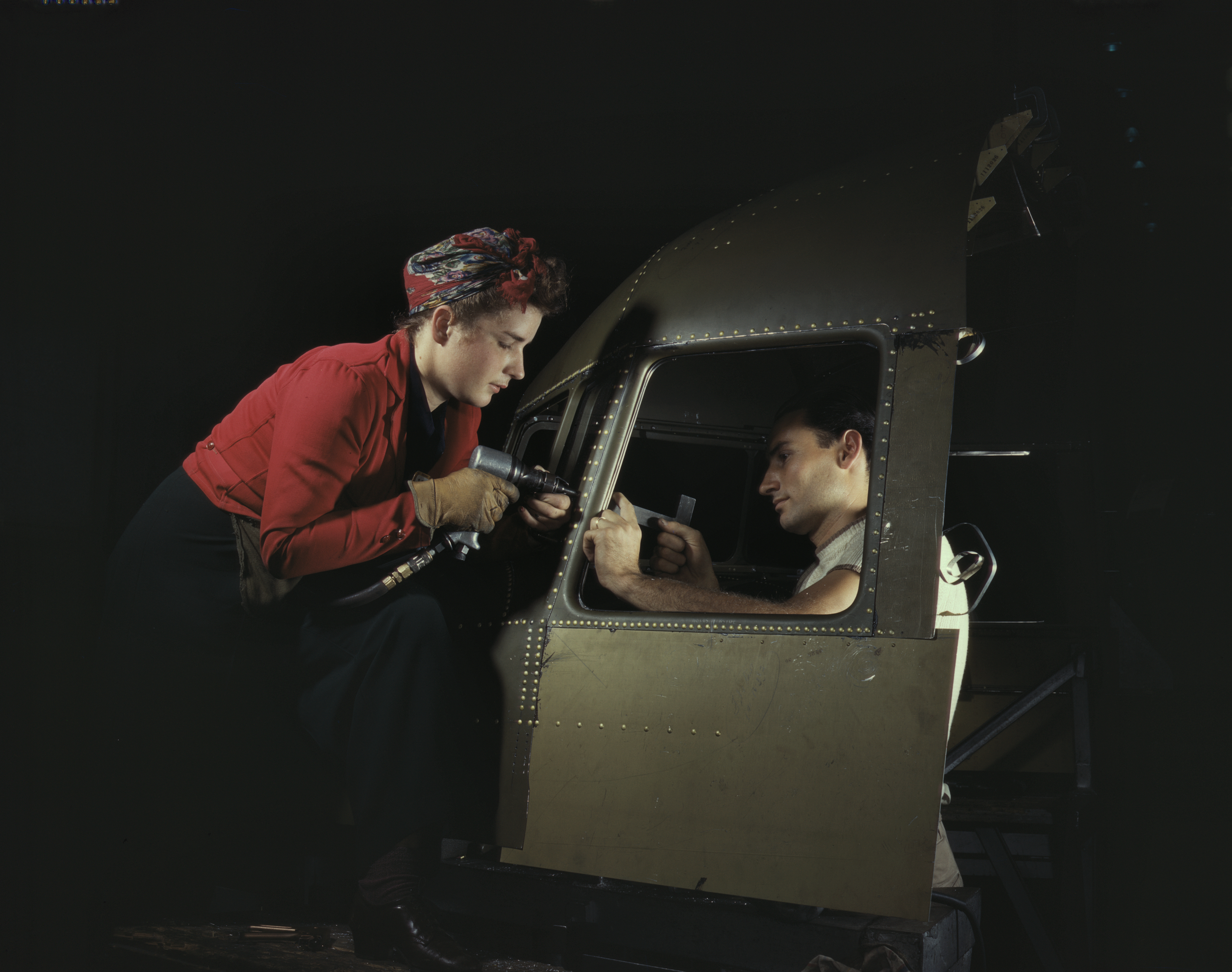 Woman and Man Working on C-47 Cockpit Shell