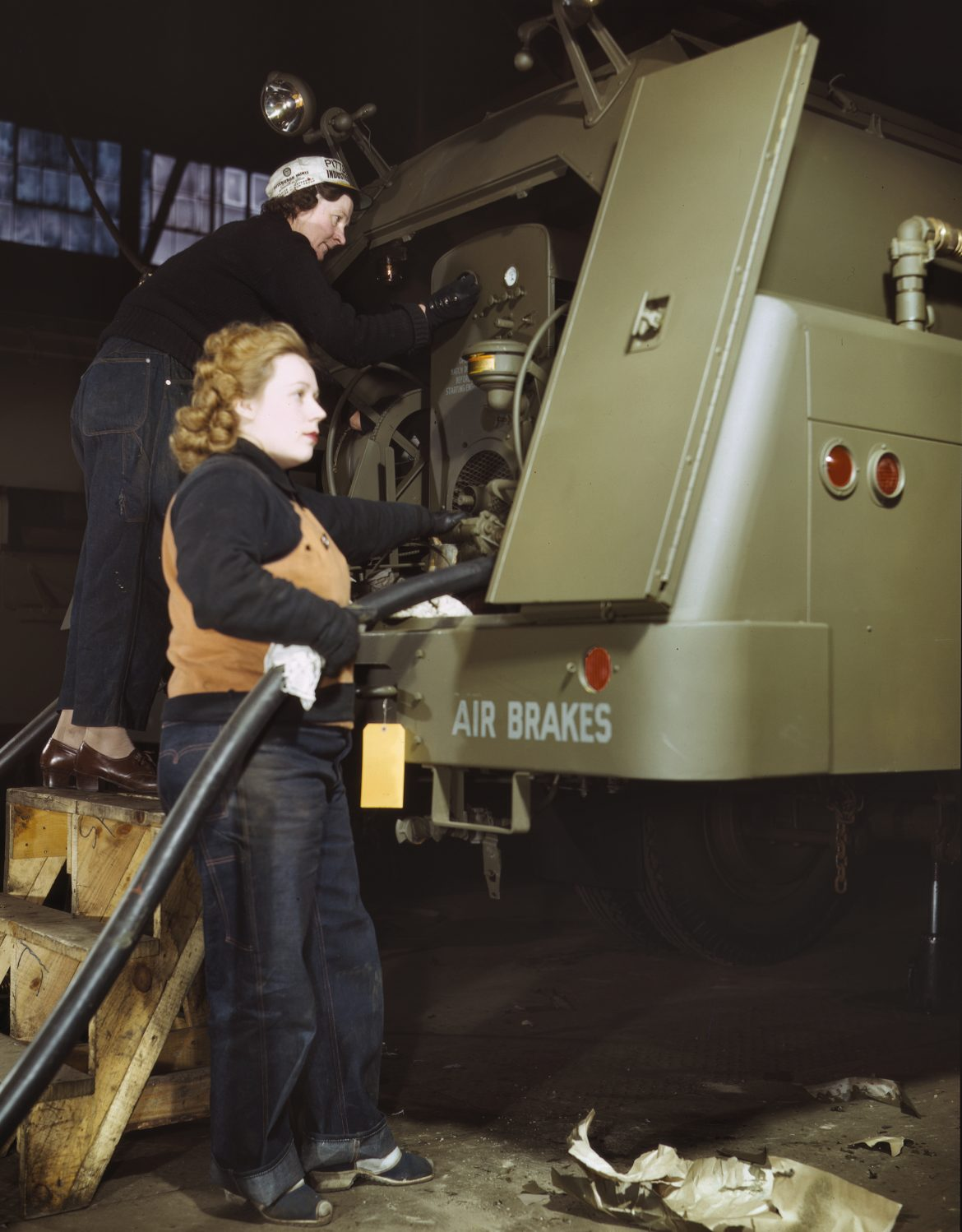 Women War Workers Check Over Gasoline Trailers