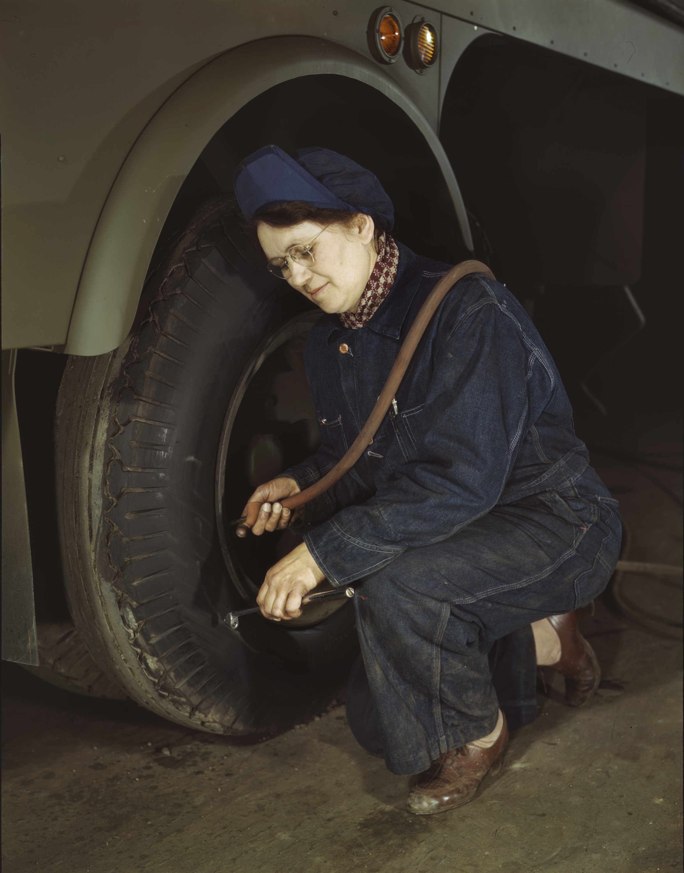 Army Wife Checks Trailer Tires for Heil and Company