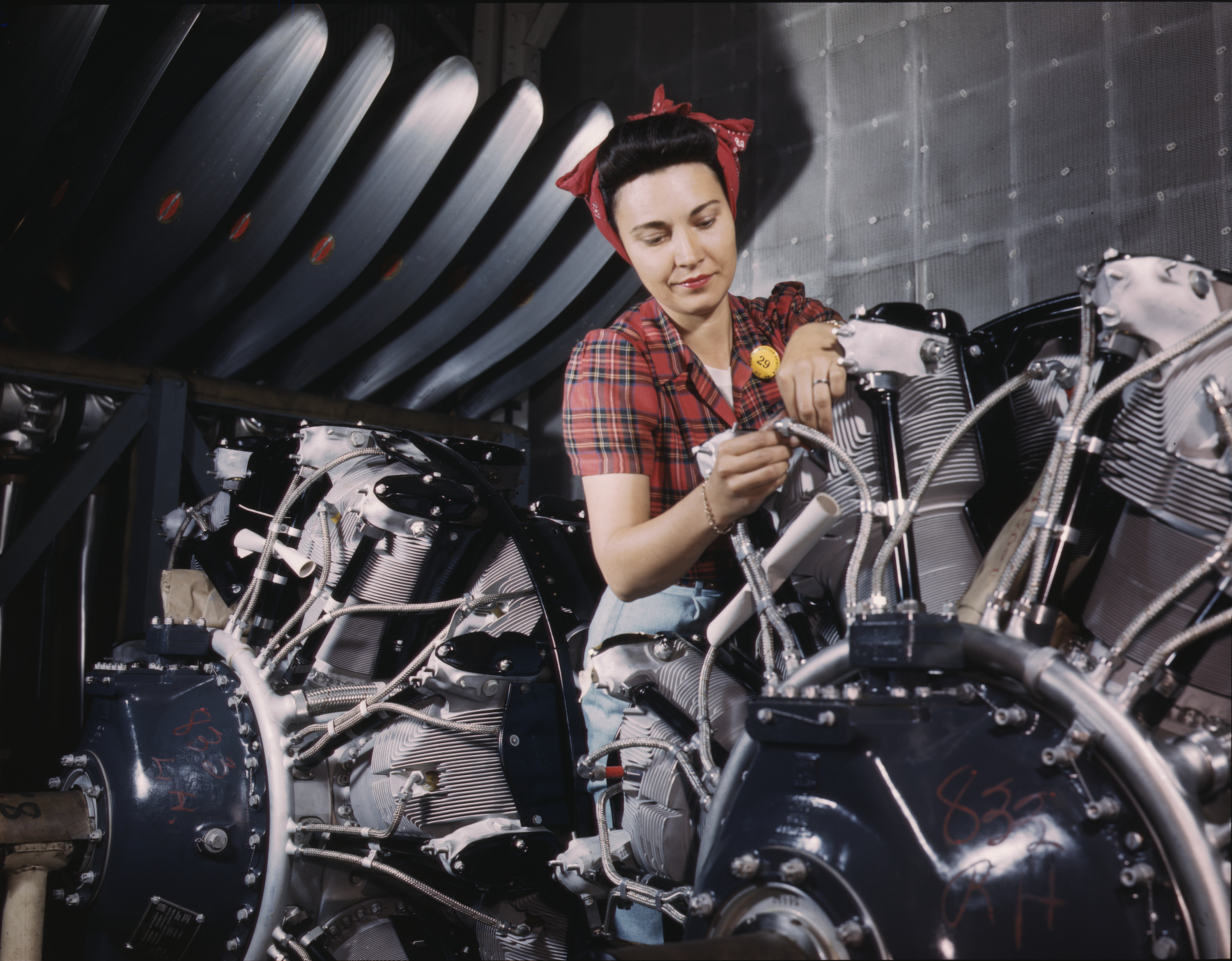 Woman Works on Airplane Motor at North American