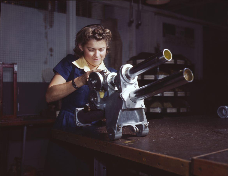 Woman Works on P-51 Landing Gear Mechanism