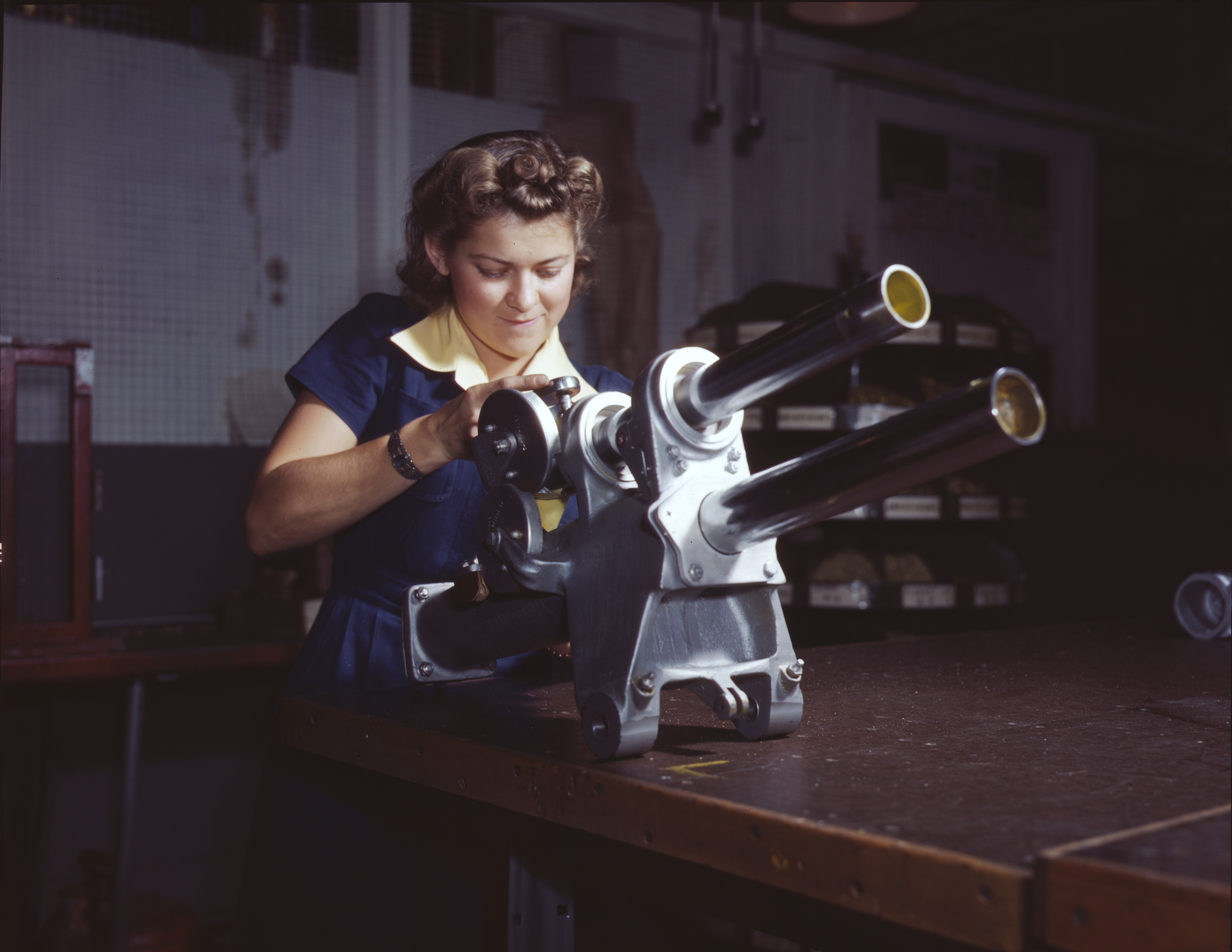 Woman Works on P-51 Landing Gear Mechanism