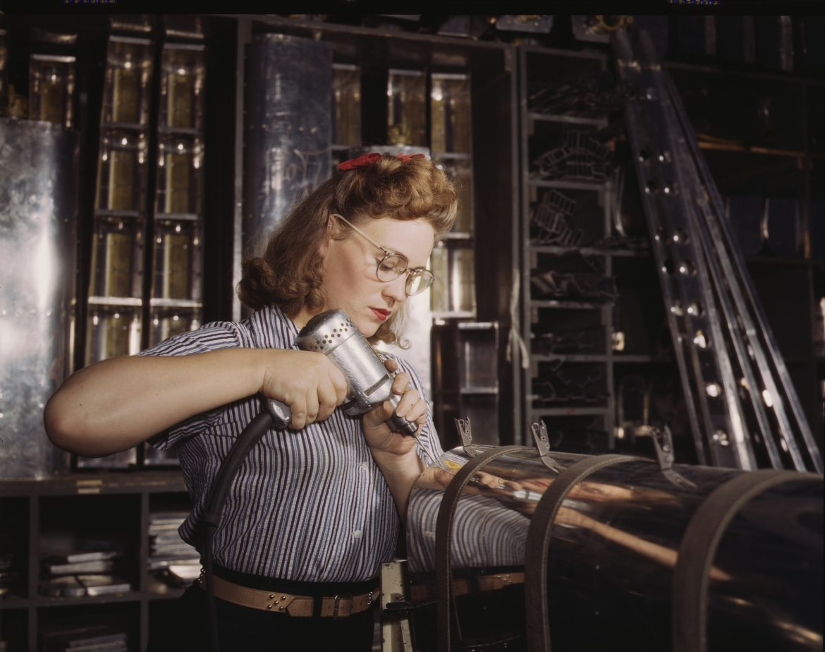 Woman Worker Assembles Aircraft Stabilizer Part