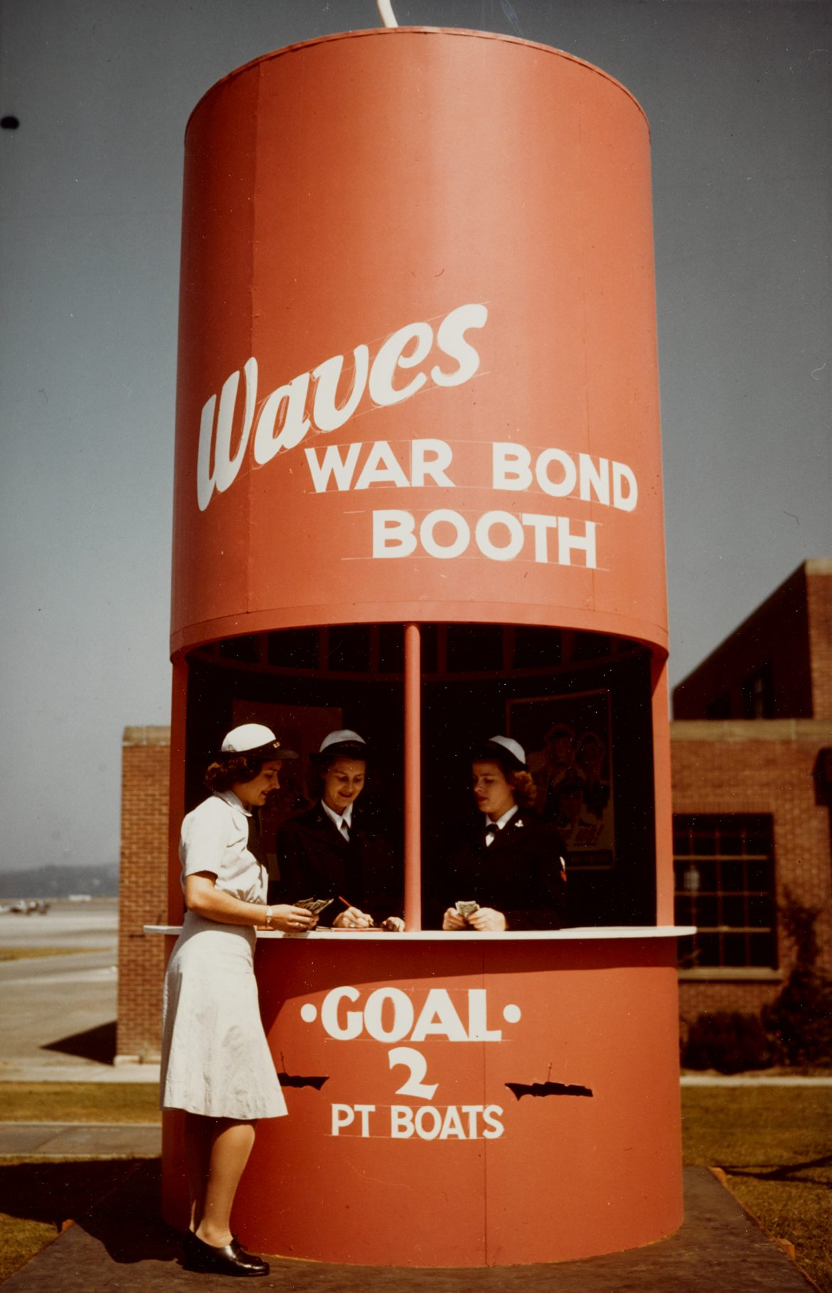 WAVES Sell War Bonds from Firecracker-Shaped Booth