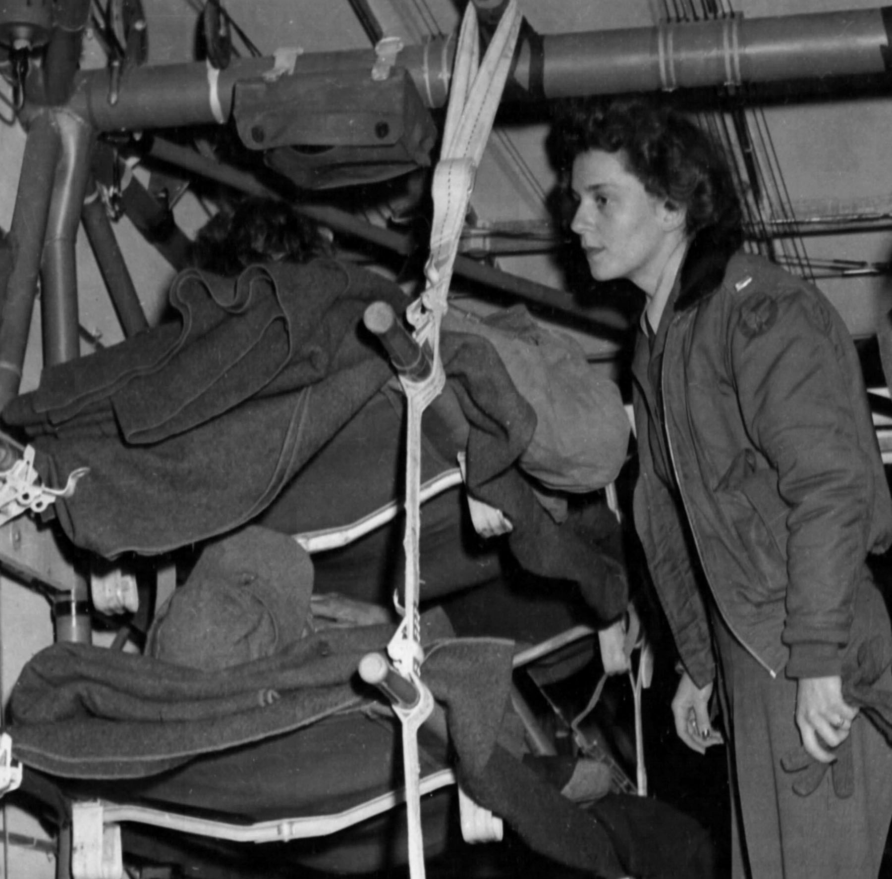 Army Flight Nurse Tends to Patients in CG-4A Glider