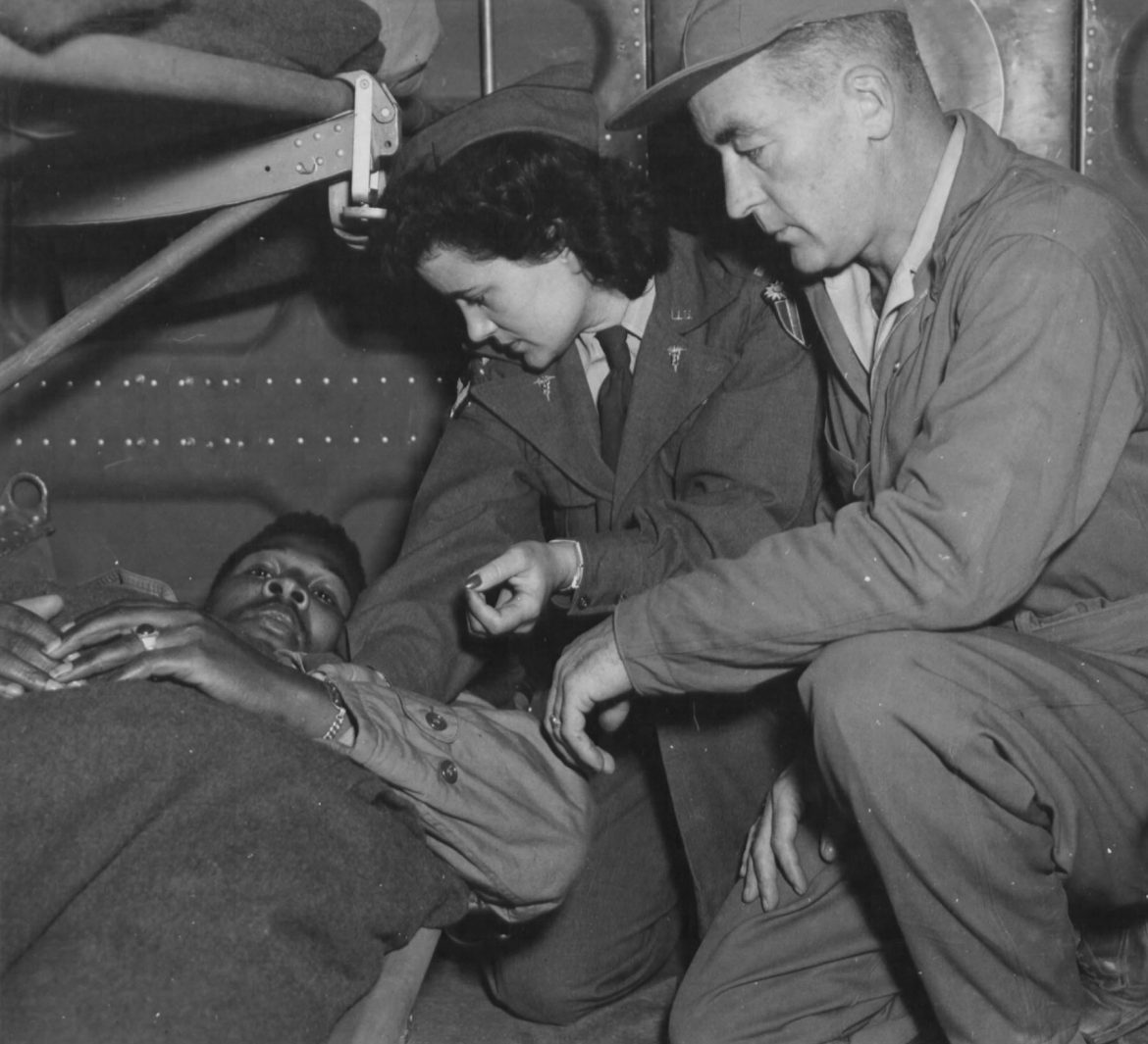 Army Flight Nurse Checks a Patient on Flight Over India