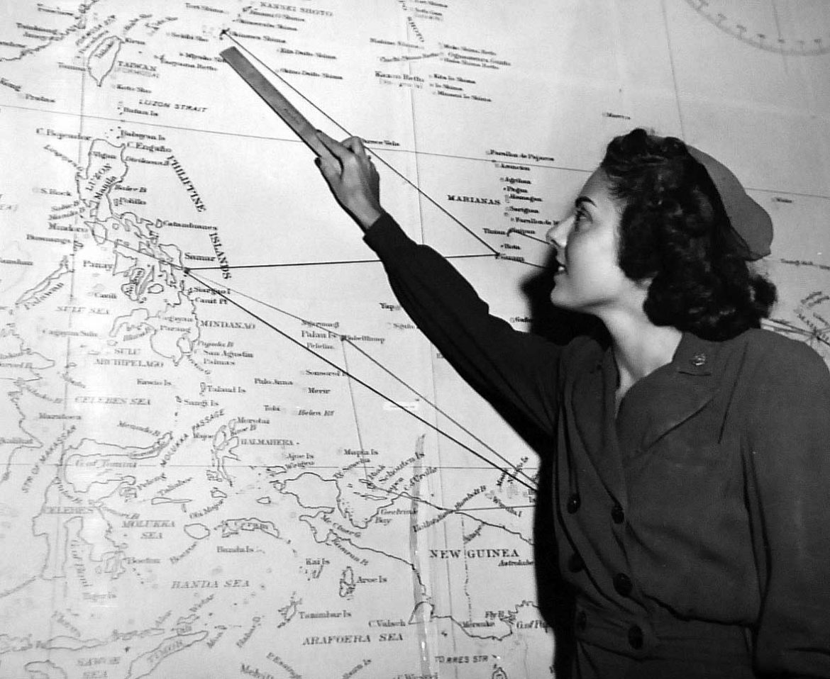 Flight Nurse Examining Map of Pacific