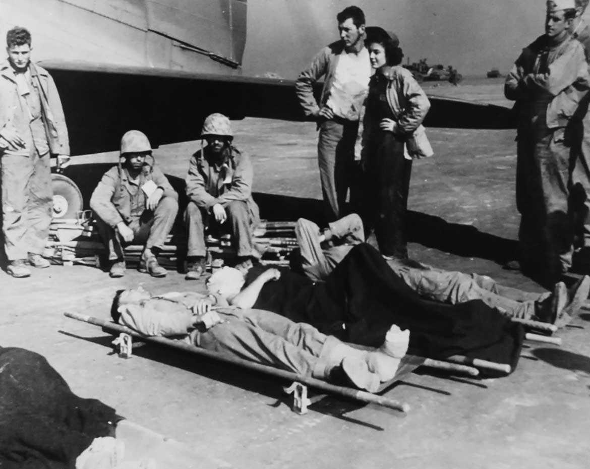 Navy Flight Nurse Aids in Evacuating Wounded from Iwo Jima