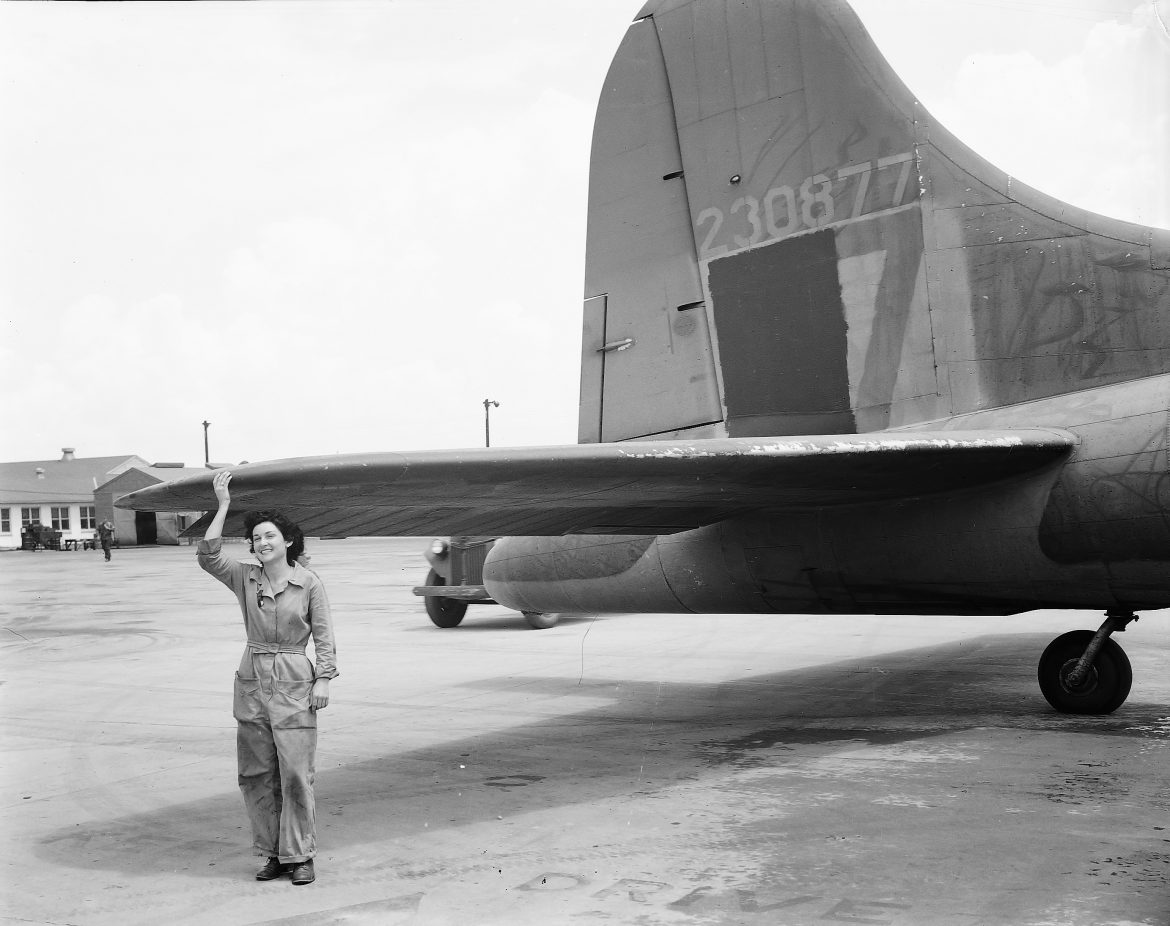 WAC Aircraft Mechanic Poses With B-17 at Tyndall Field