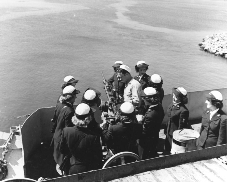 WAVES Examine Machine Gun on USS Mission Bay Tour