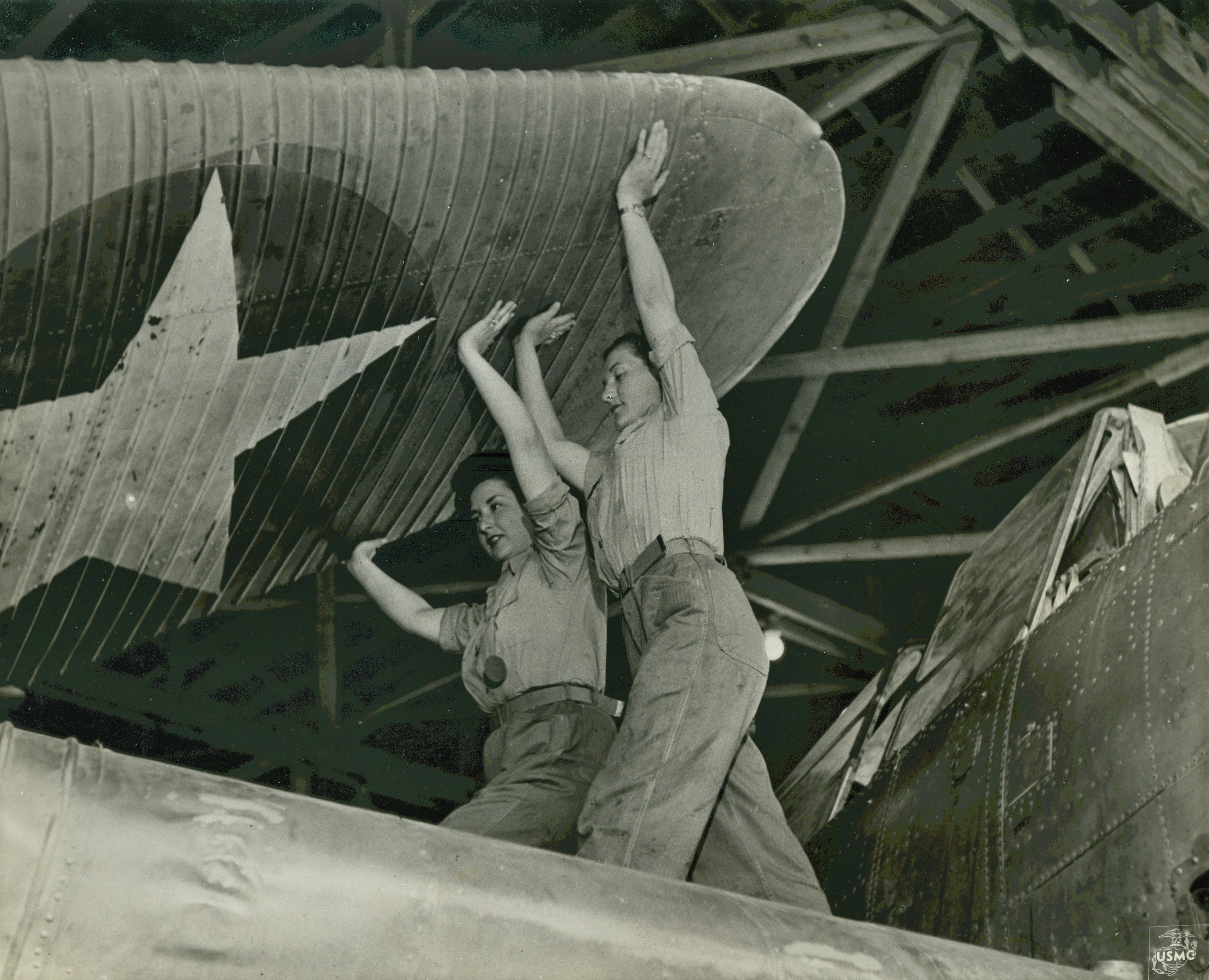 Women Marines Unfold Wing Section