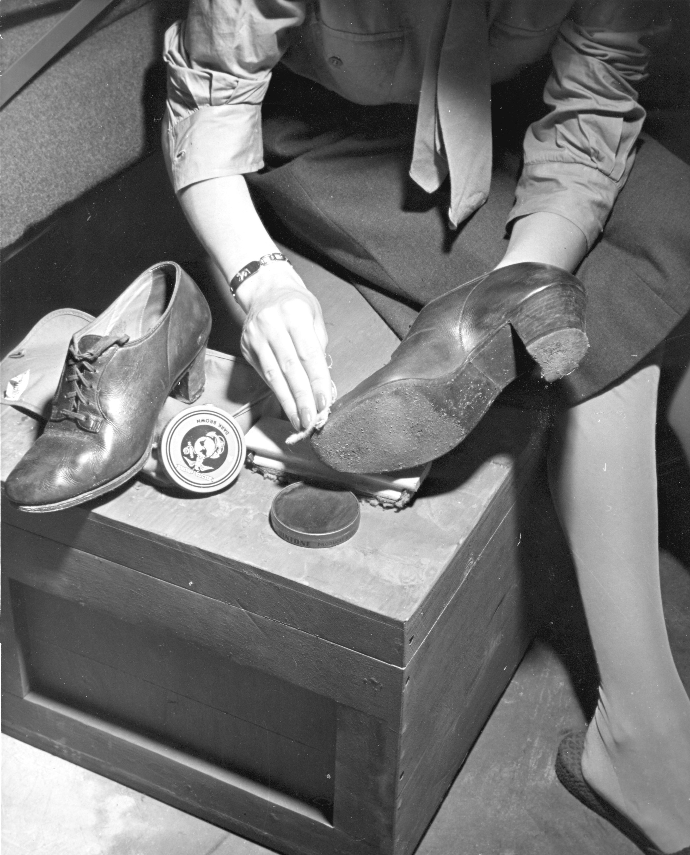 Woman Marine Polishing her Shoes