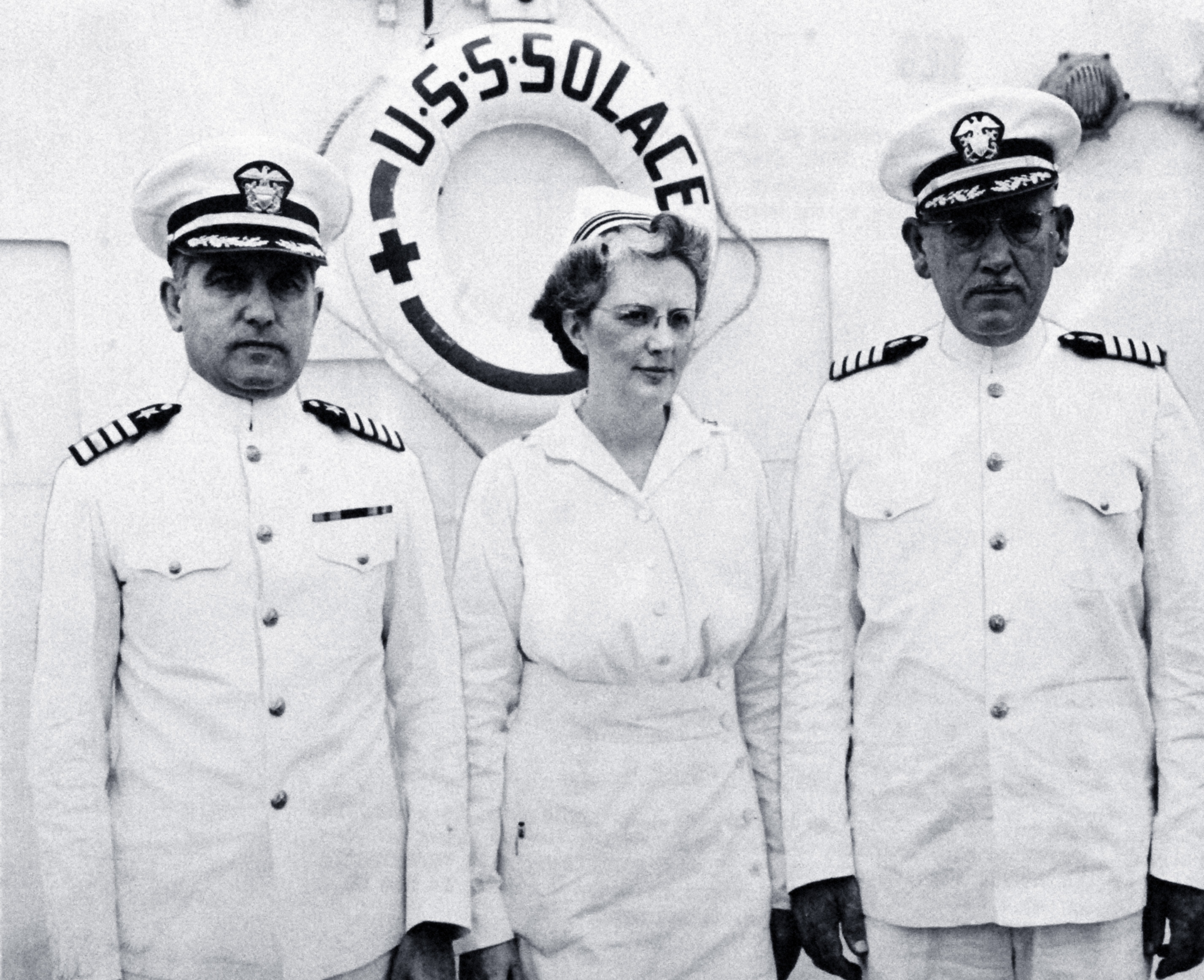 Navy Nurse with Captains on Hospital Ship USS Solace
