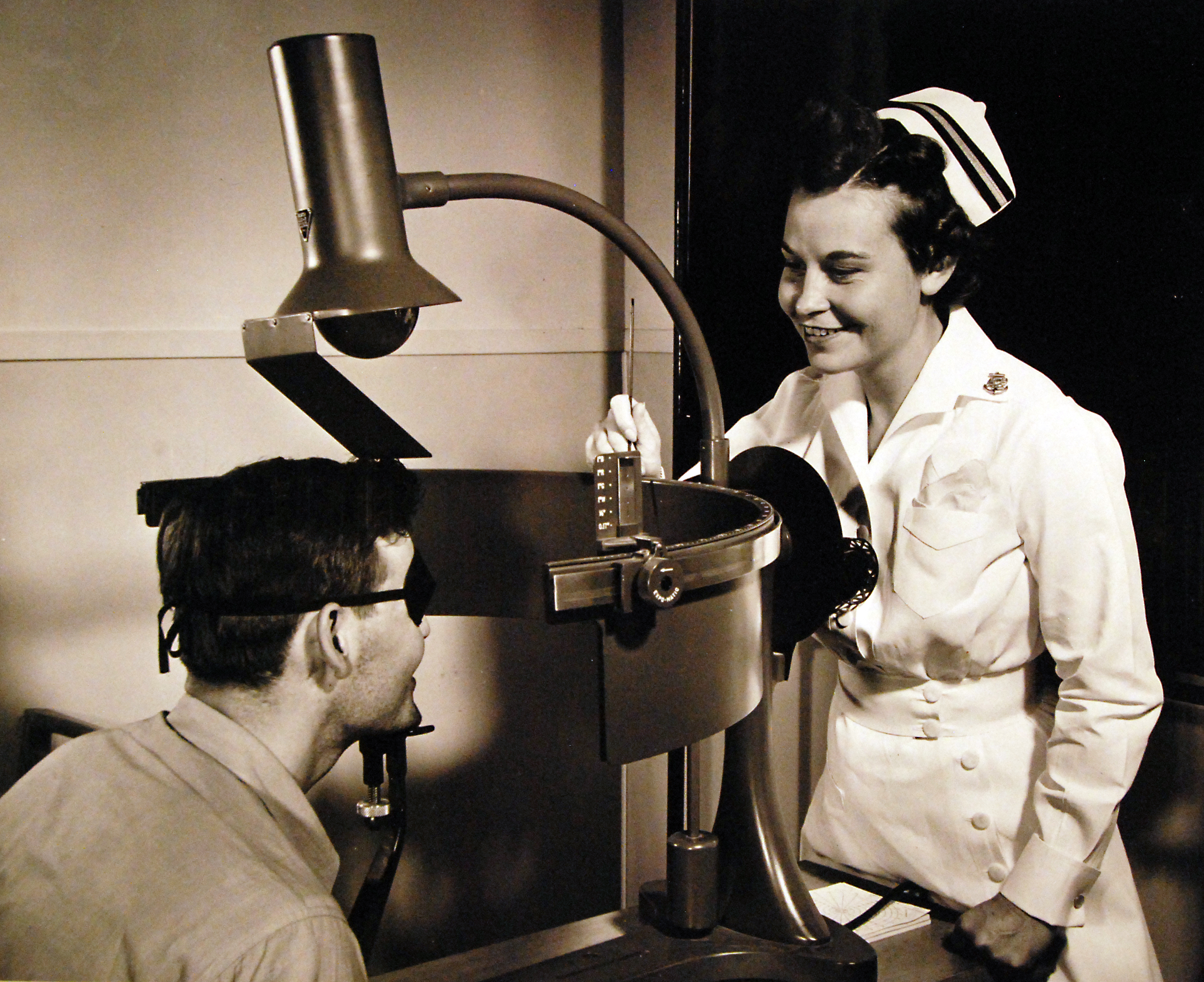 Navy Nurse Examines Patient's Field of Vision