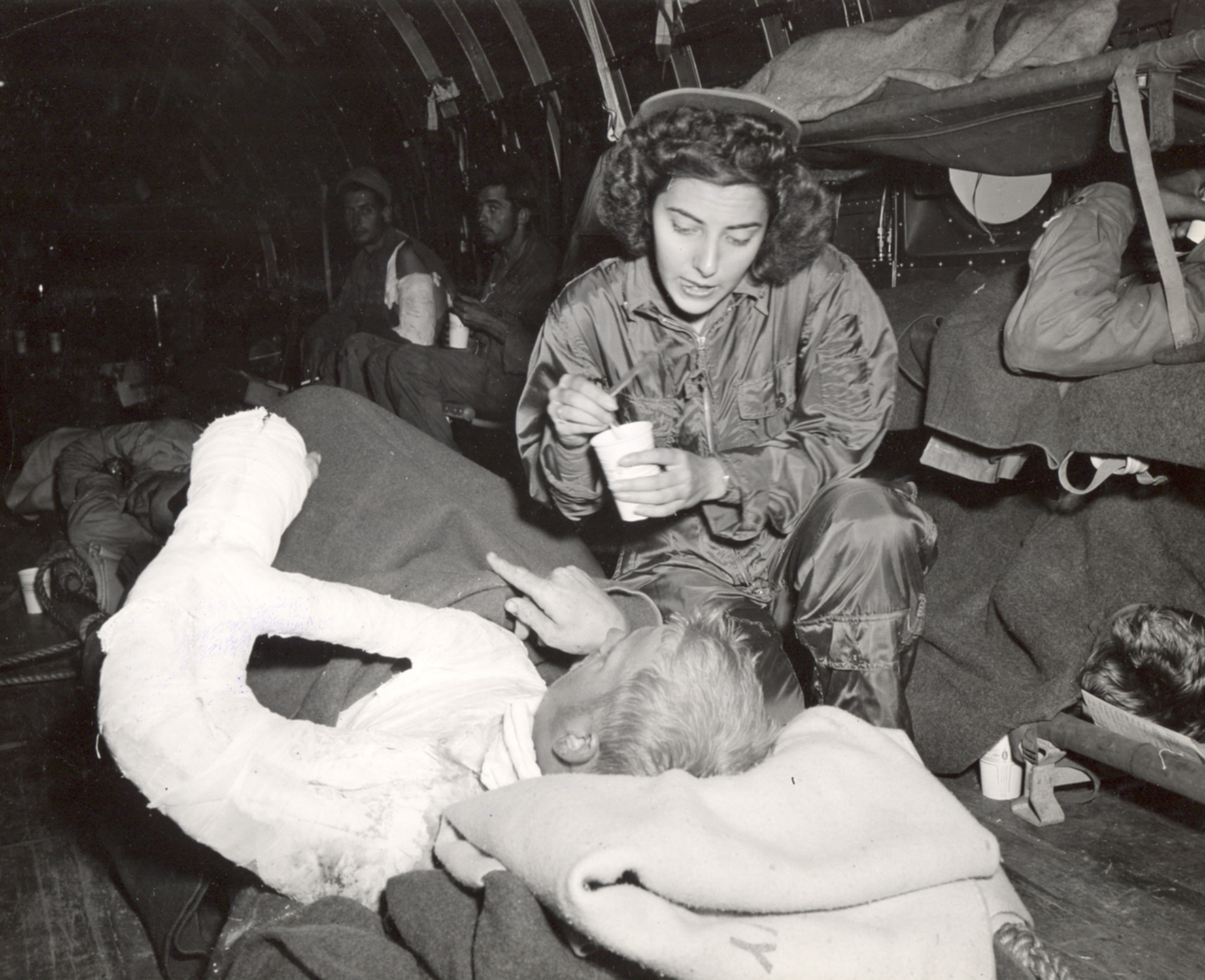 Flight Nurse Cares for Wounded on Trip from Iwo Jima