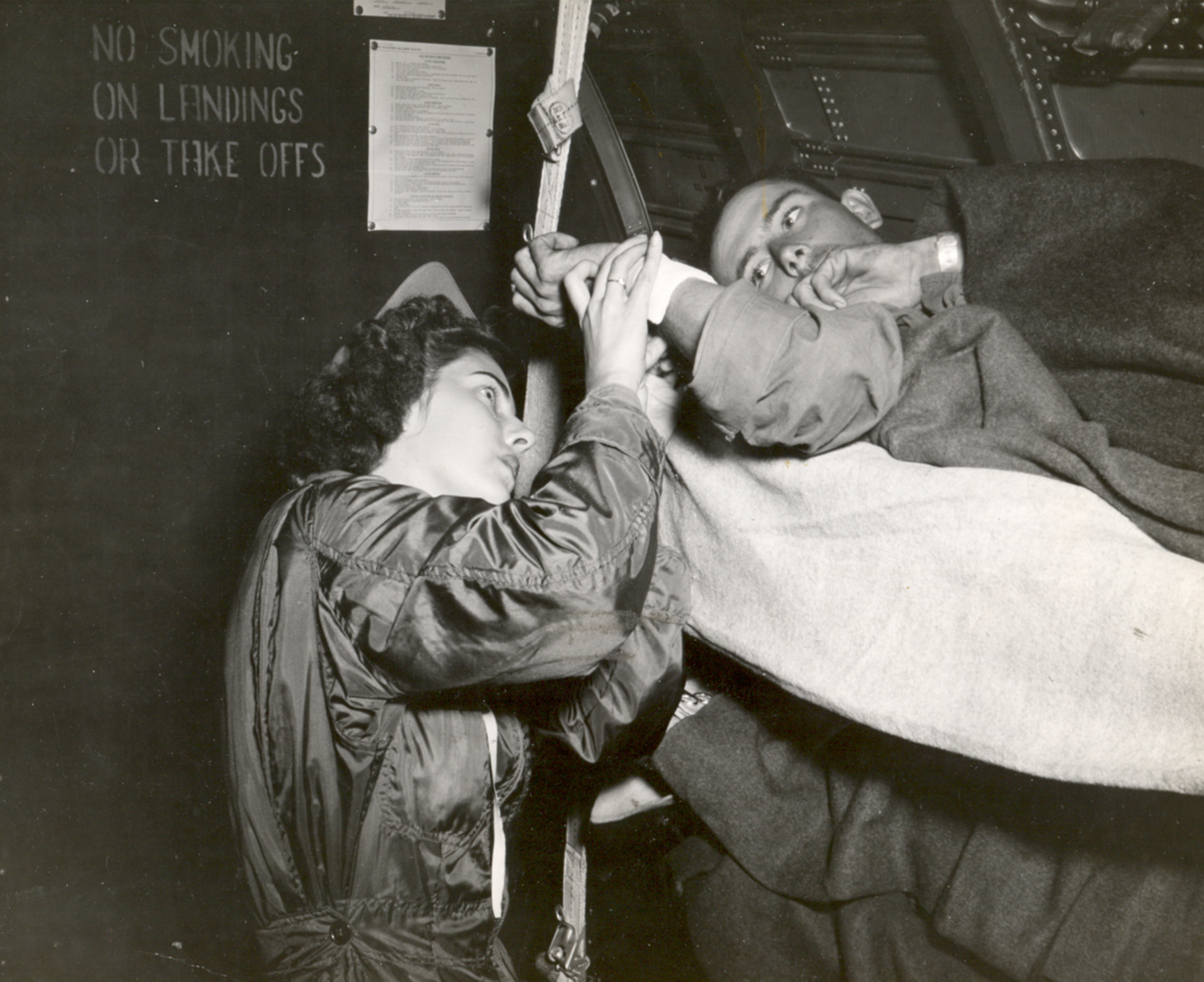 Navy Flight Nurse Jane Kendeigh Checks Patient Inflight