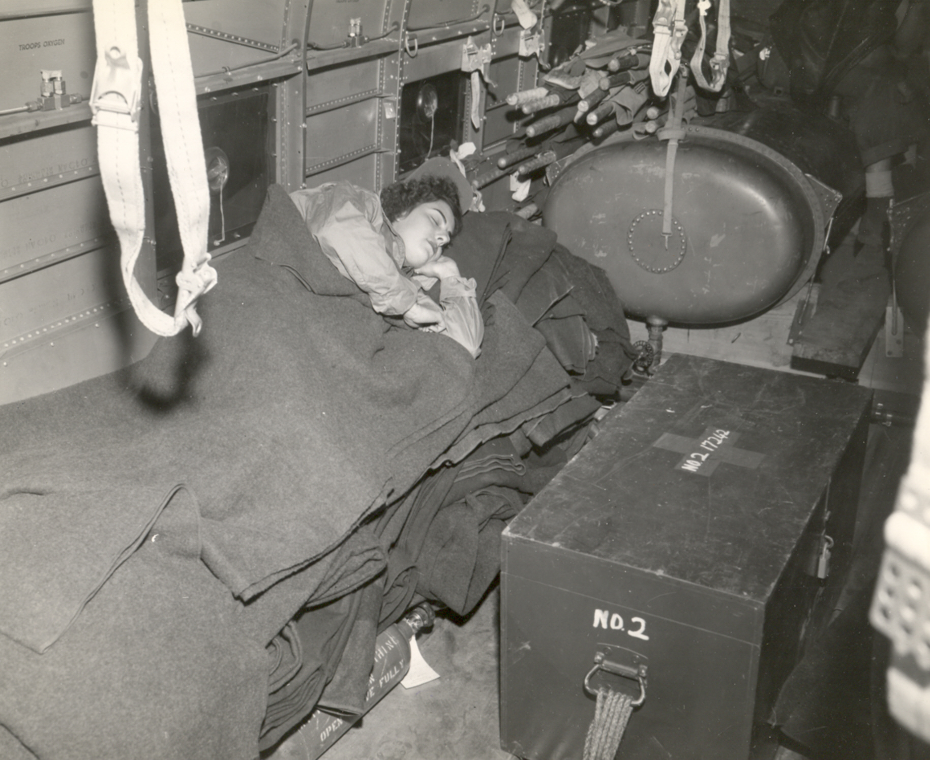 Navy Flight Nurse Naps on Flight from Iwo Jima