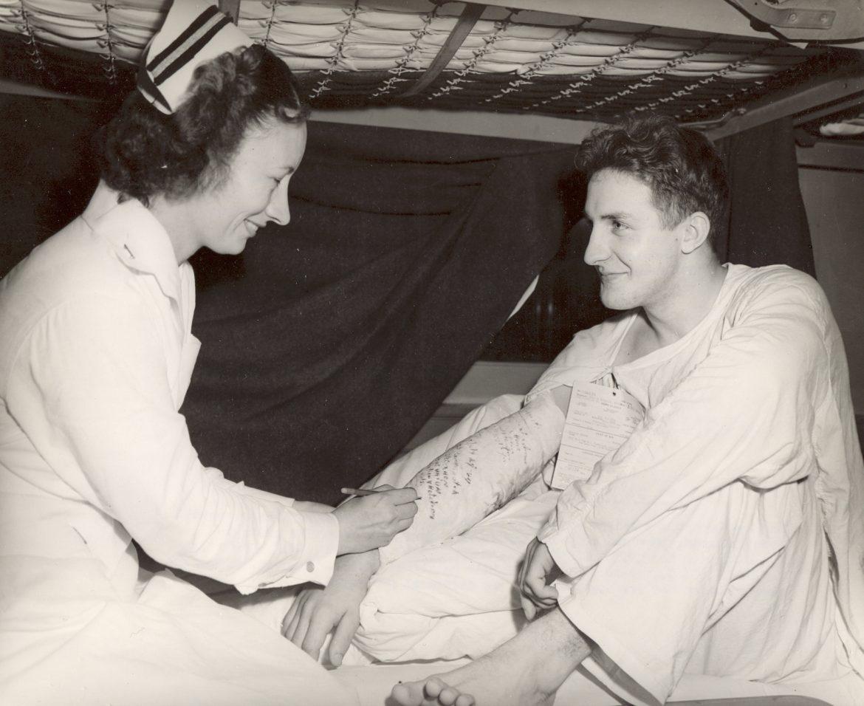 Navy Nurse Signs a Sailor's Cast
