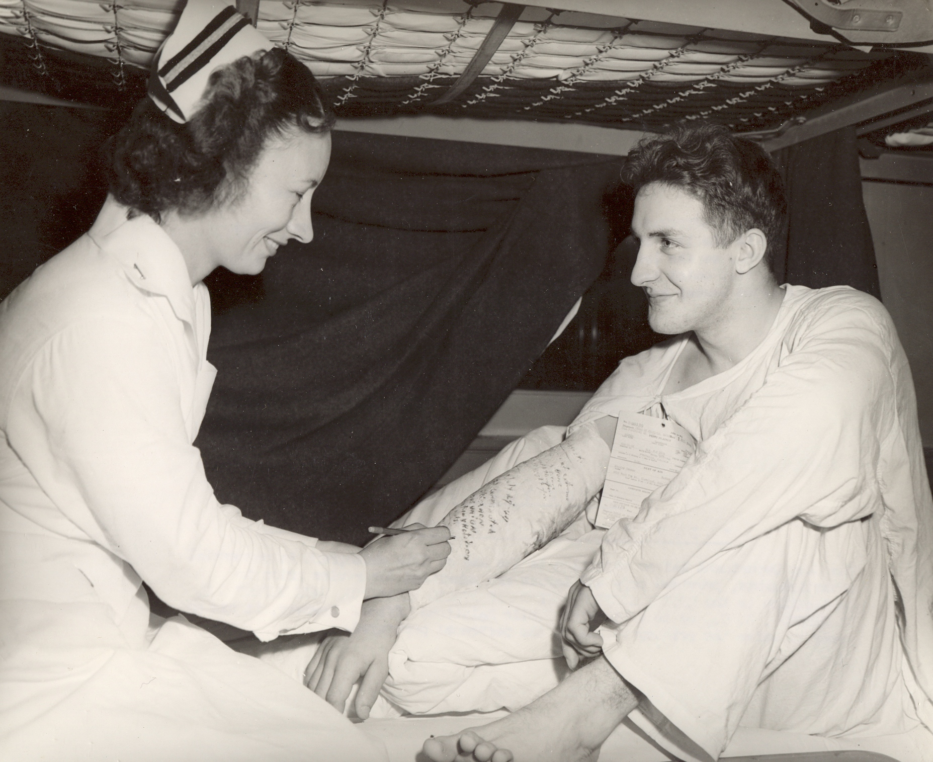 Navy Nurse Signs a Sailor's Cast