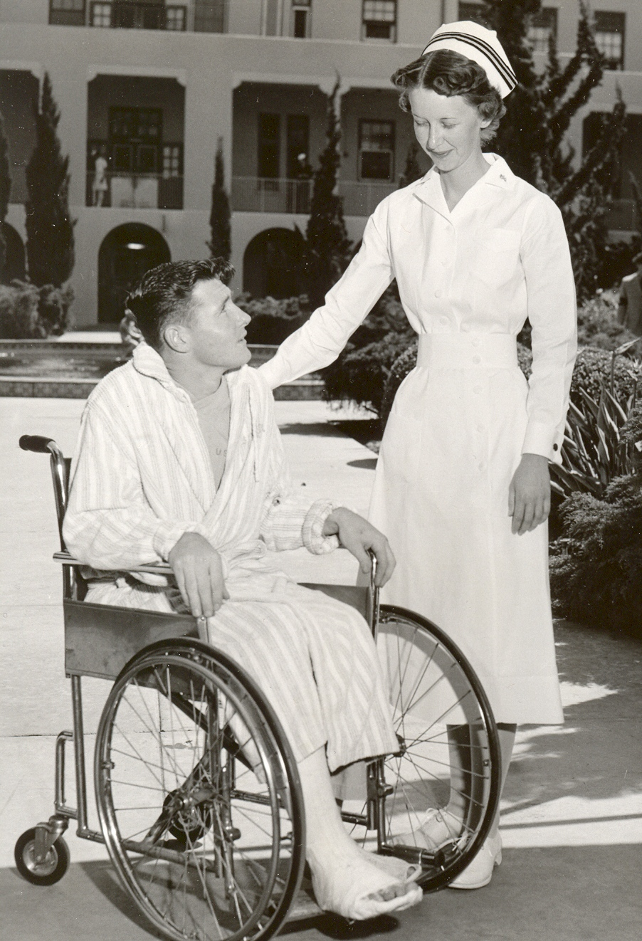 Navy Nurse with Patient in Wheelchair