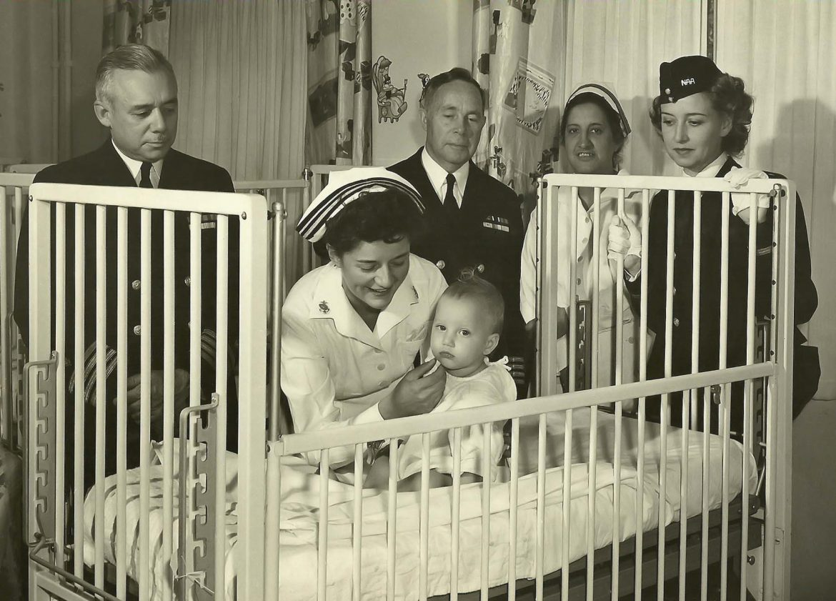 Navy Nurse Checks Baby at Naval Hospital San Diego