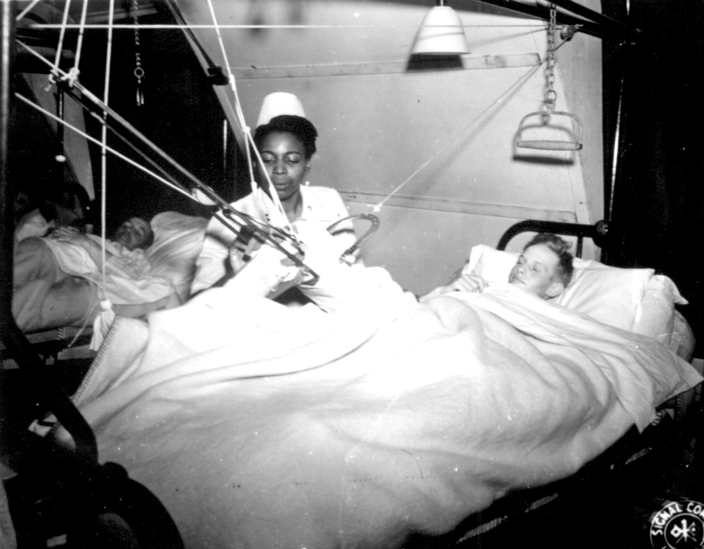 Army Nurse Tends to POW Patient in Military Hospital