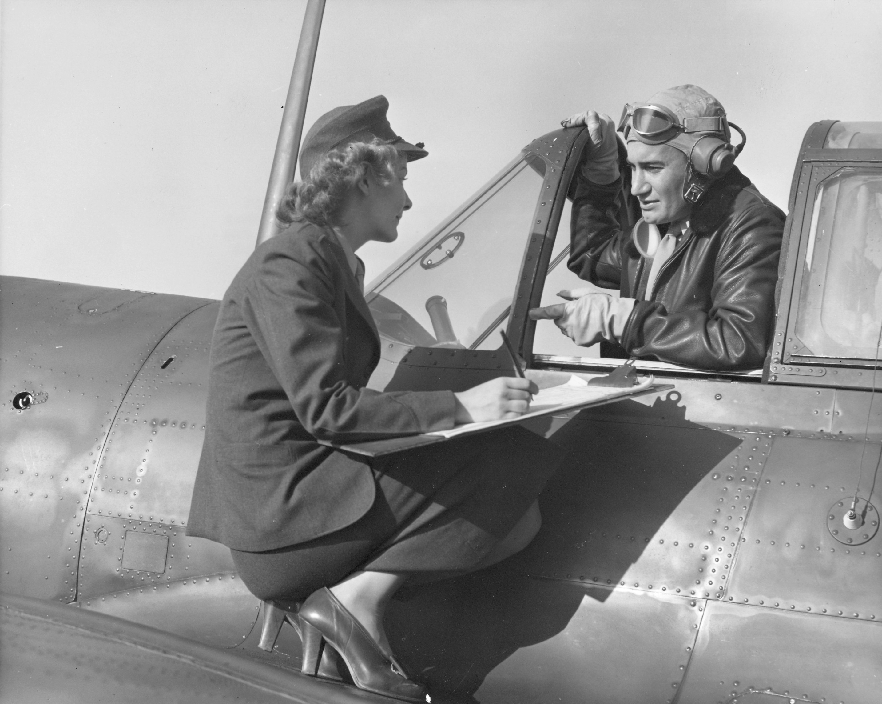 Woman Marine Checks Out Pilot Pre-Flight