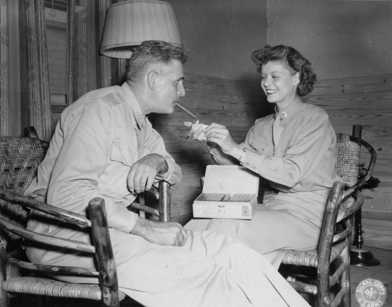 WAAC Lieutenant Lights Cigar for Her Father