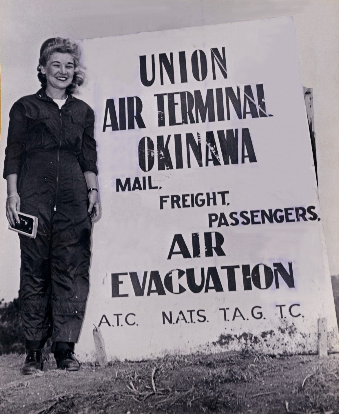 Navy Flight Nurse with Air Terminal Okinawa Sign