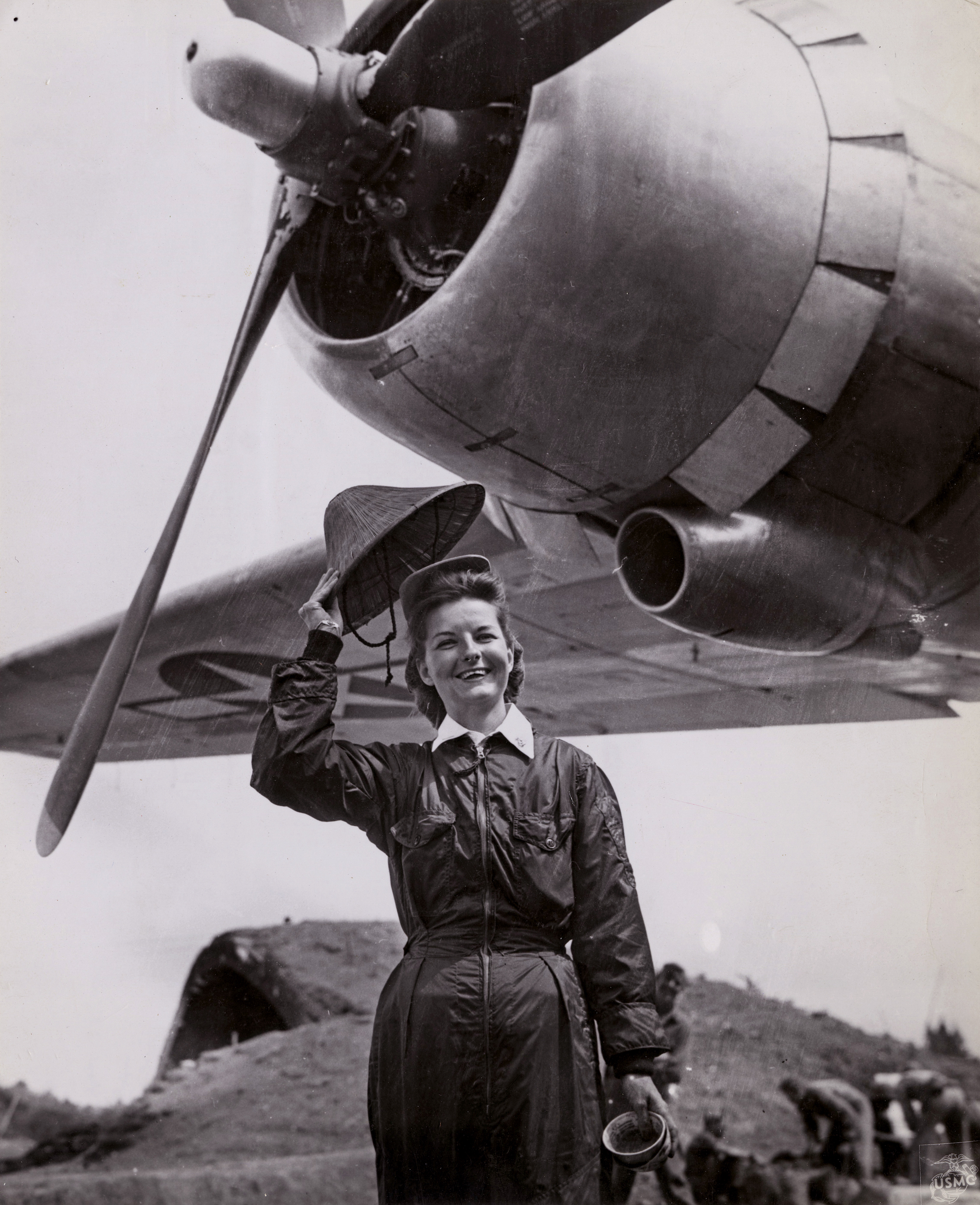 Navy Flight Nurse Waves Straw Hat in Okinawa