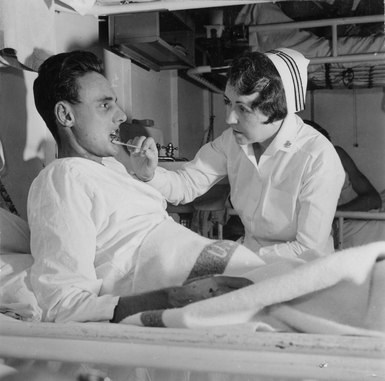 Navy Nurse Tends to Patient on USS Solace