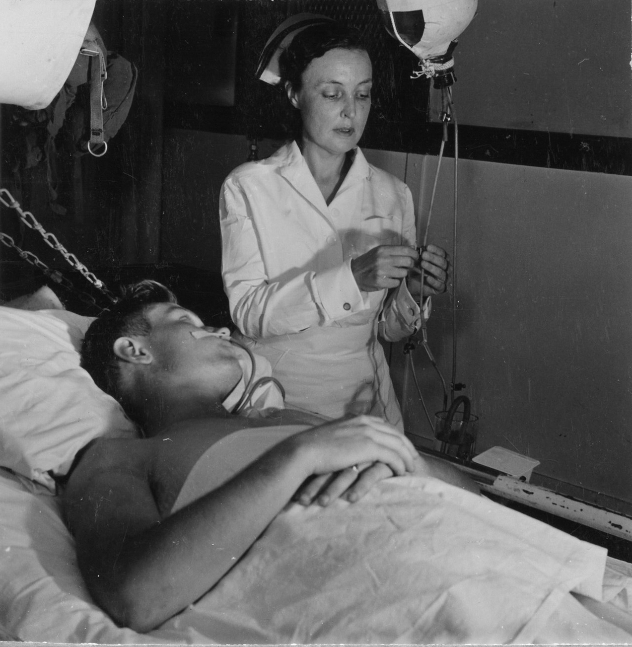 Navy Nurse Tends to Patient Aboard Hospital Ship