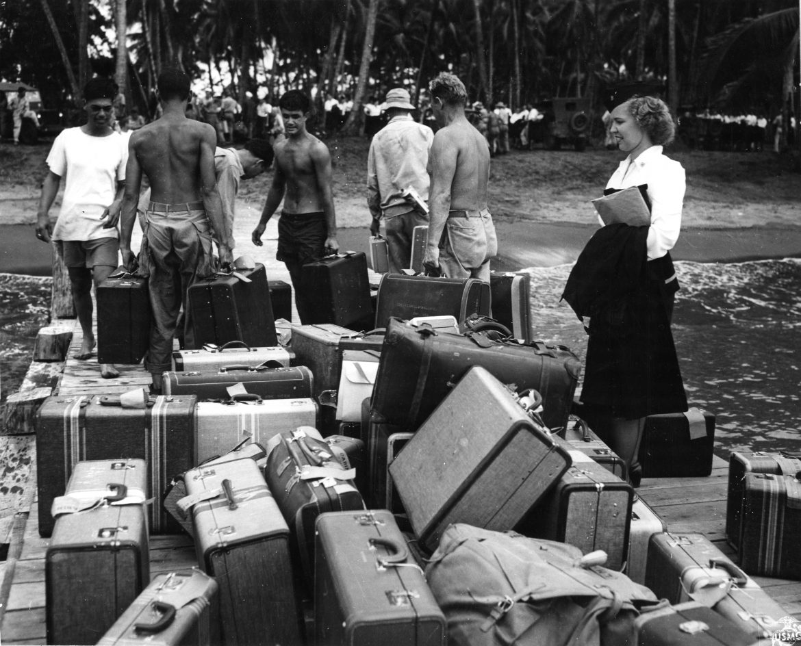 Navy Nurse Looks for Suitcase in Guadalcanal