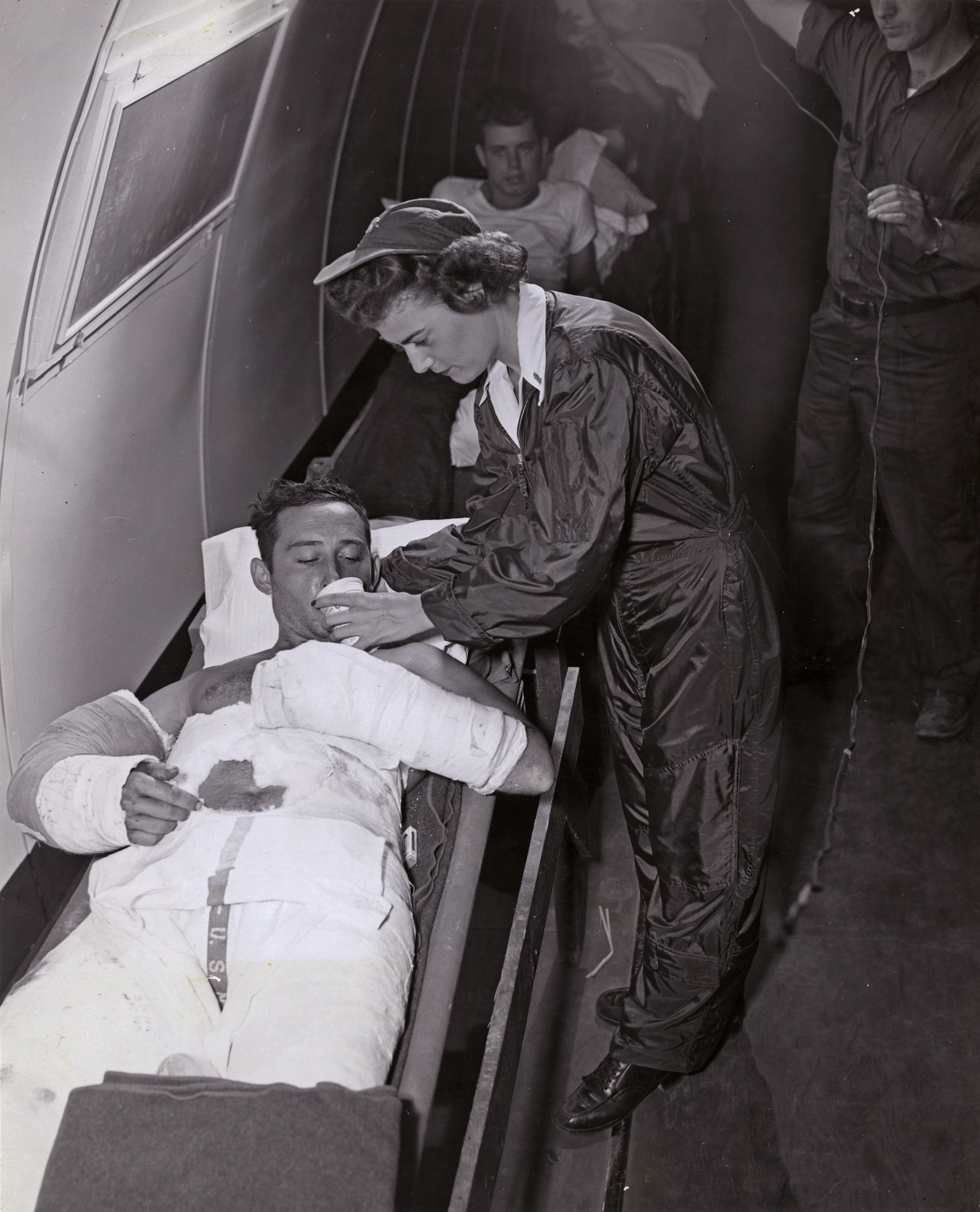 Navy Flight Nurse Tends to Patient Aboard Plane