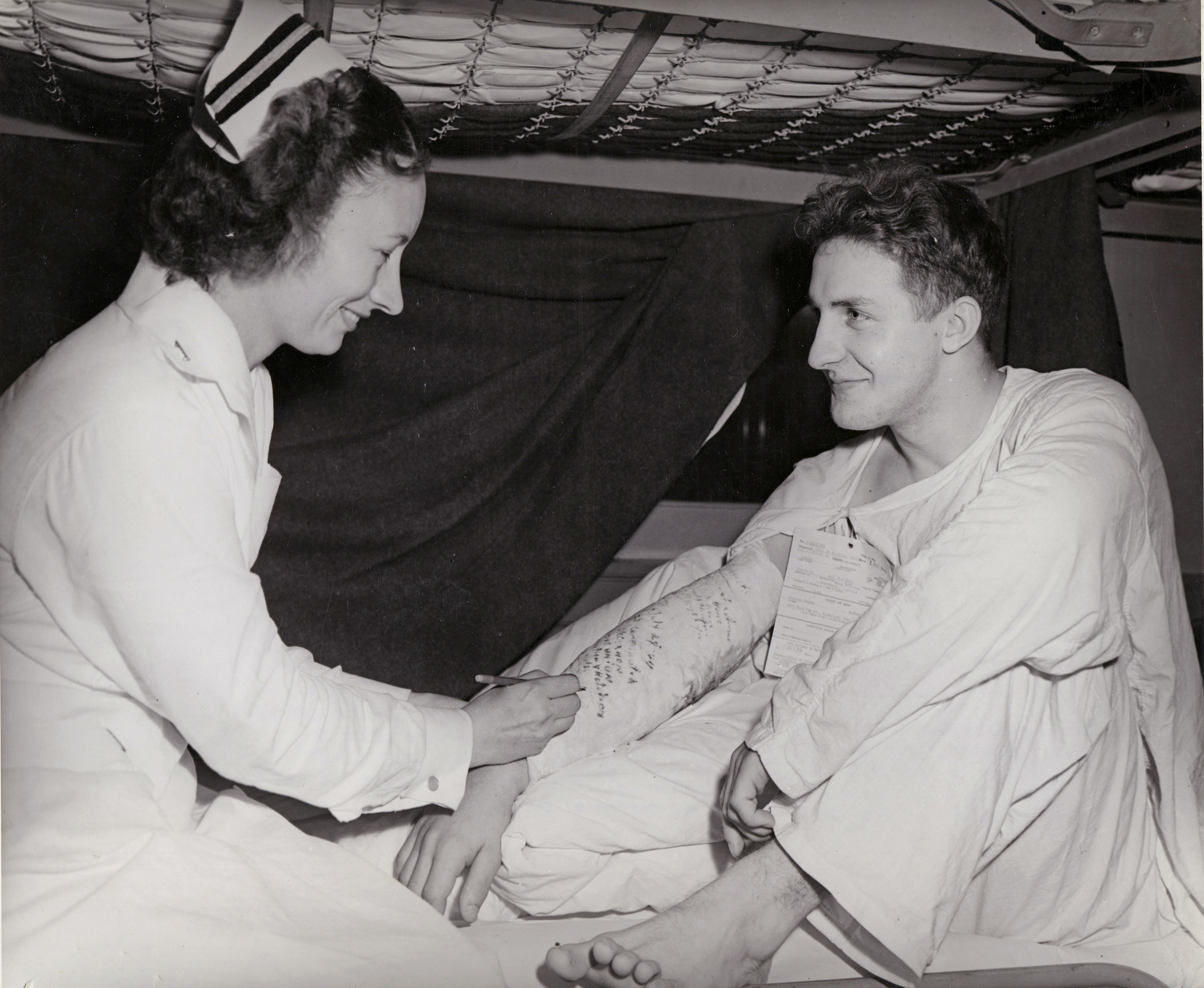 Navy Nurse Signs Sailor's Arm Cast