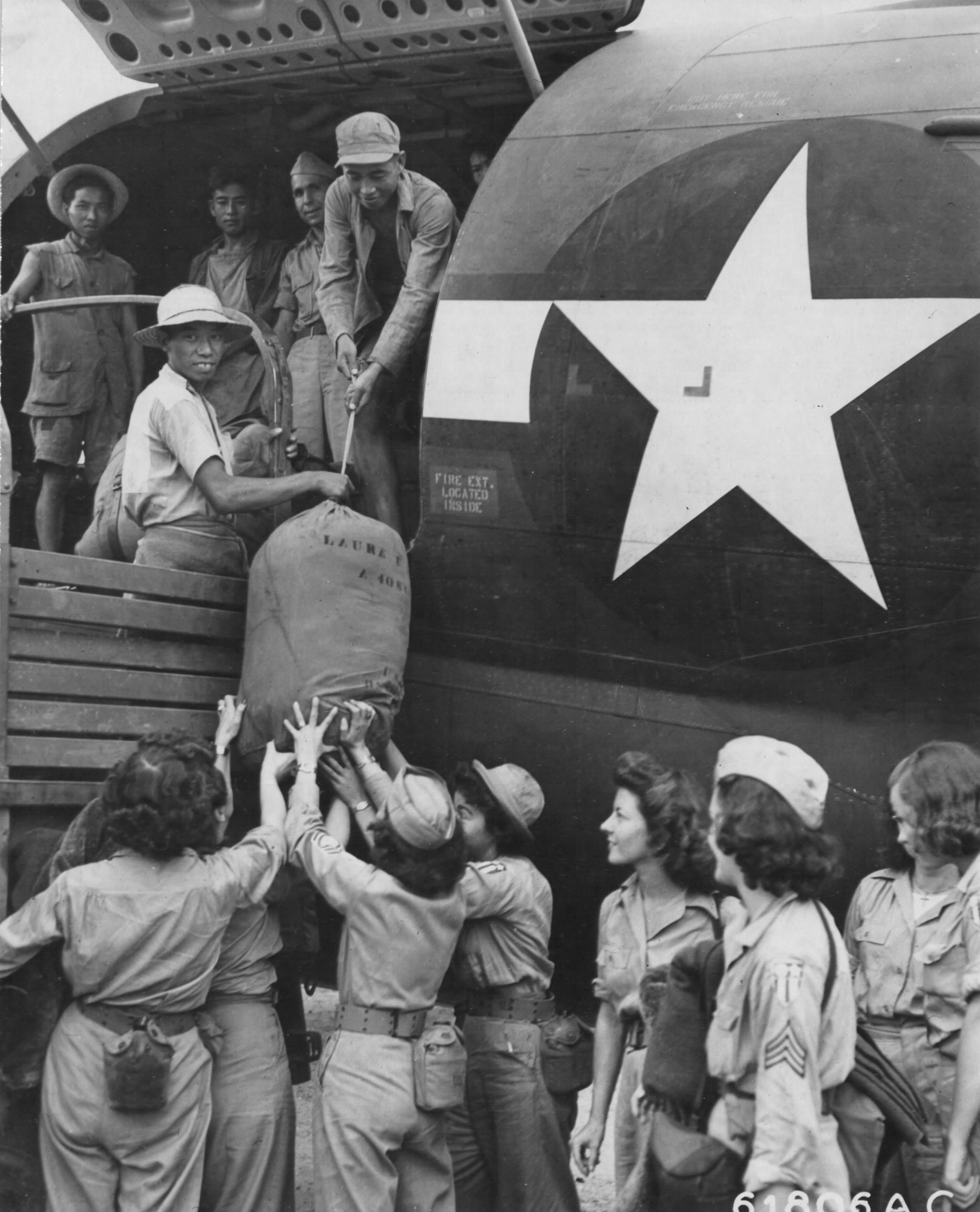 WACs Arriving in China Given a Hand by Locals