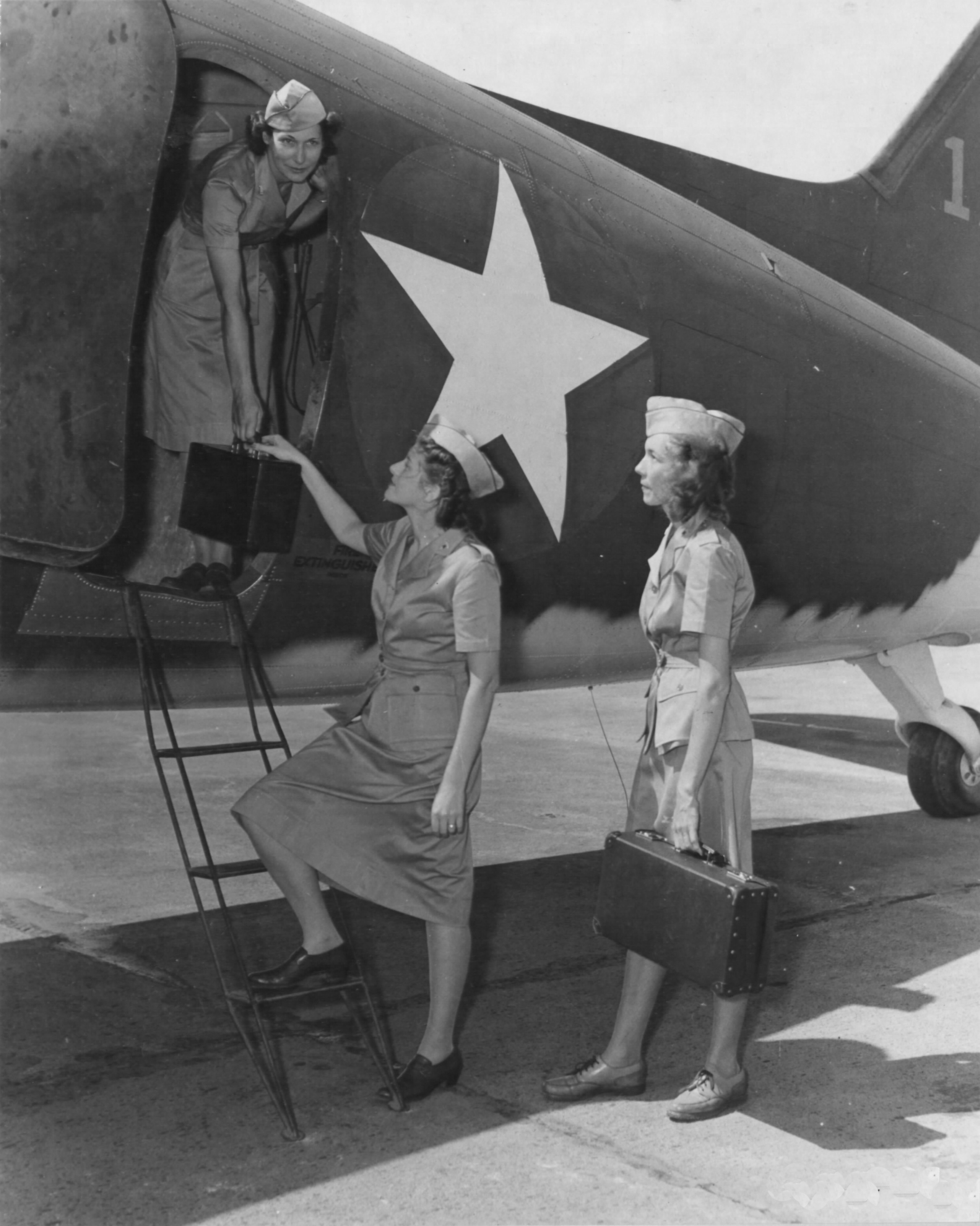 Army Flight Nurses Boarding Transport Plane