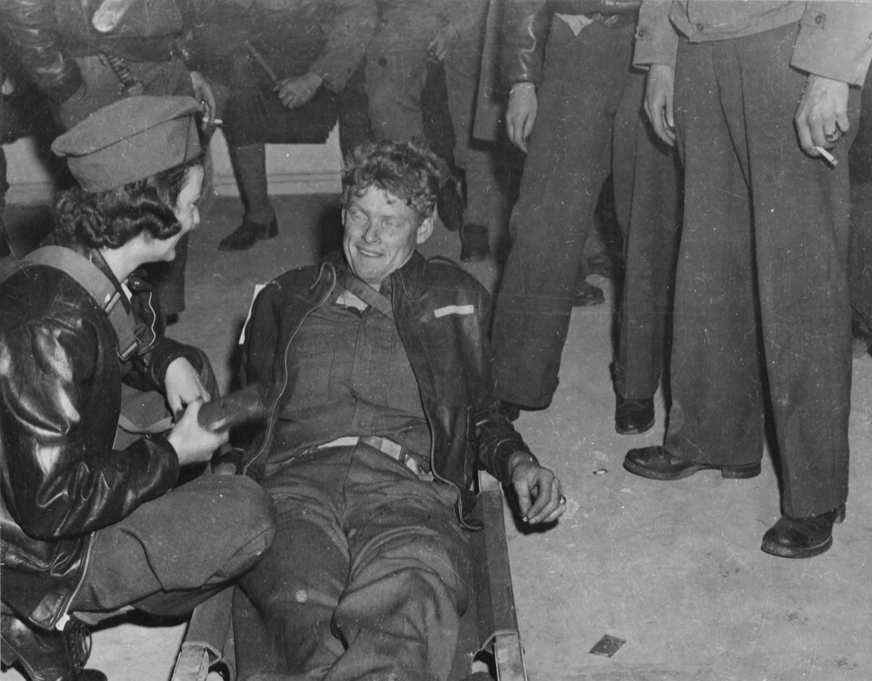 Flight Nurse Talks to Wounded Crew Member