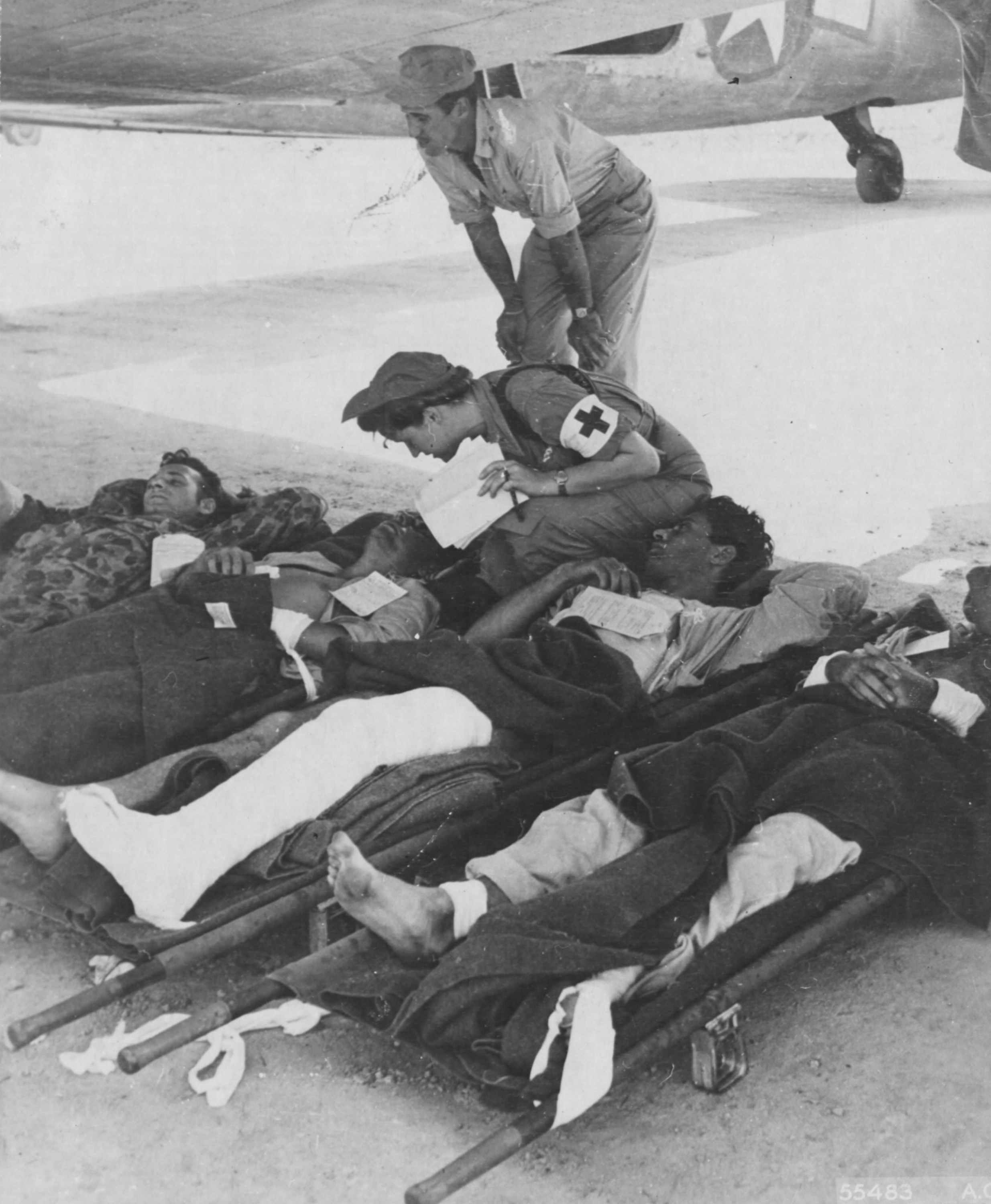 Flight Nurse Prepares Wounded for Transport