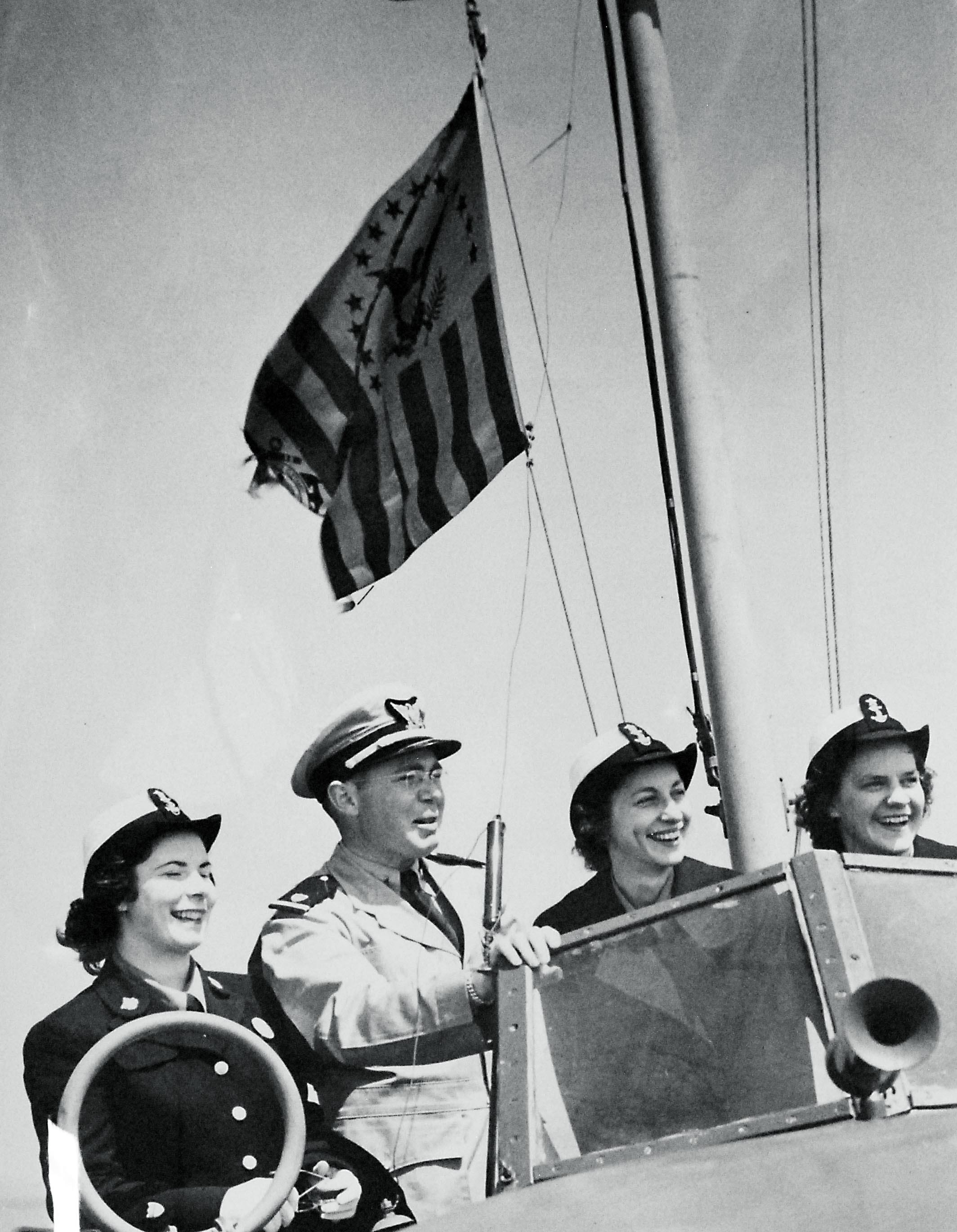 Three SPAR Cadets with Ensign on Flying Bridge