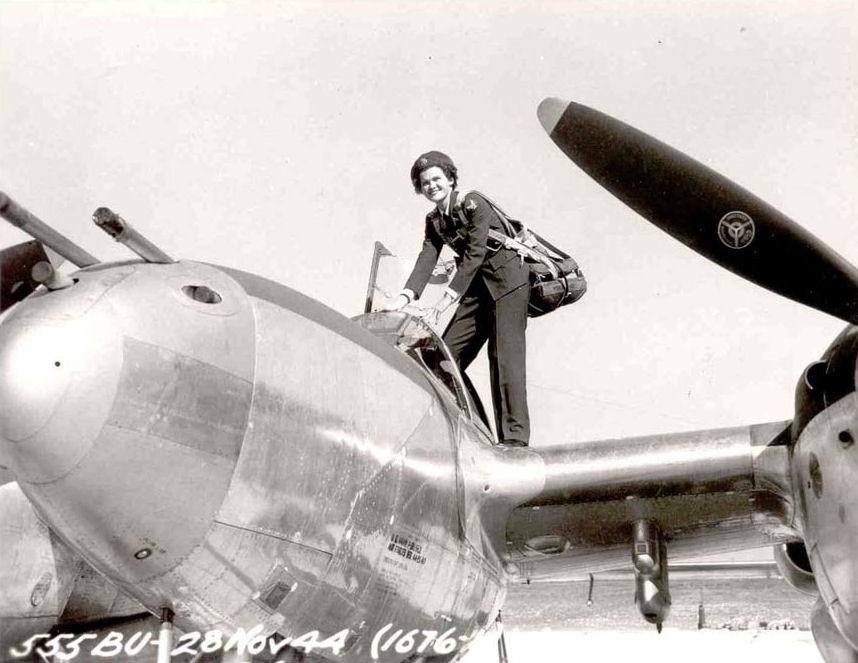 WASP Pilot Climbs Into a P-38 Aircraft