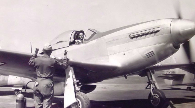 Ferry Pilot Warms Up Her P-51