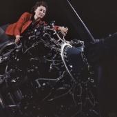 Woman at Work on Motor at Douglas Aircraft
