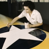 Civil Service Worker Paints Insignia on Navy Plane Wings